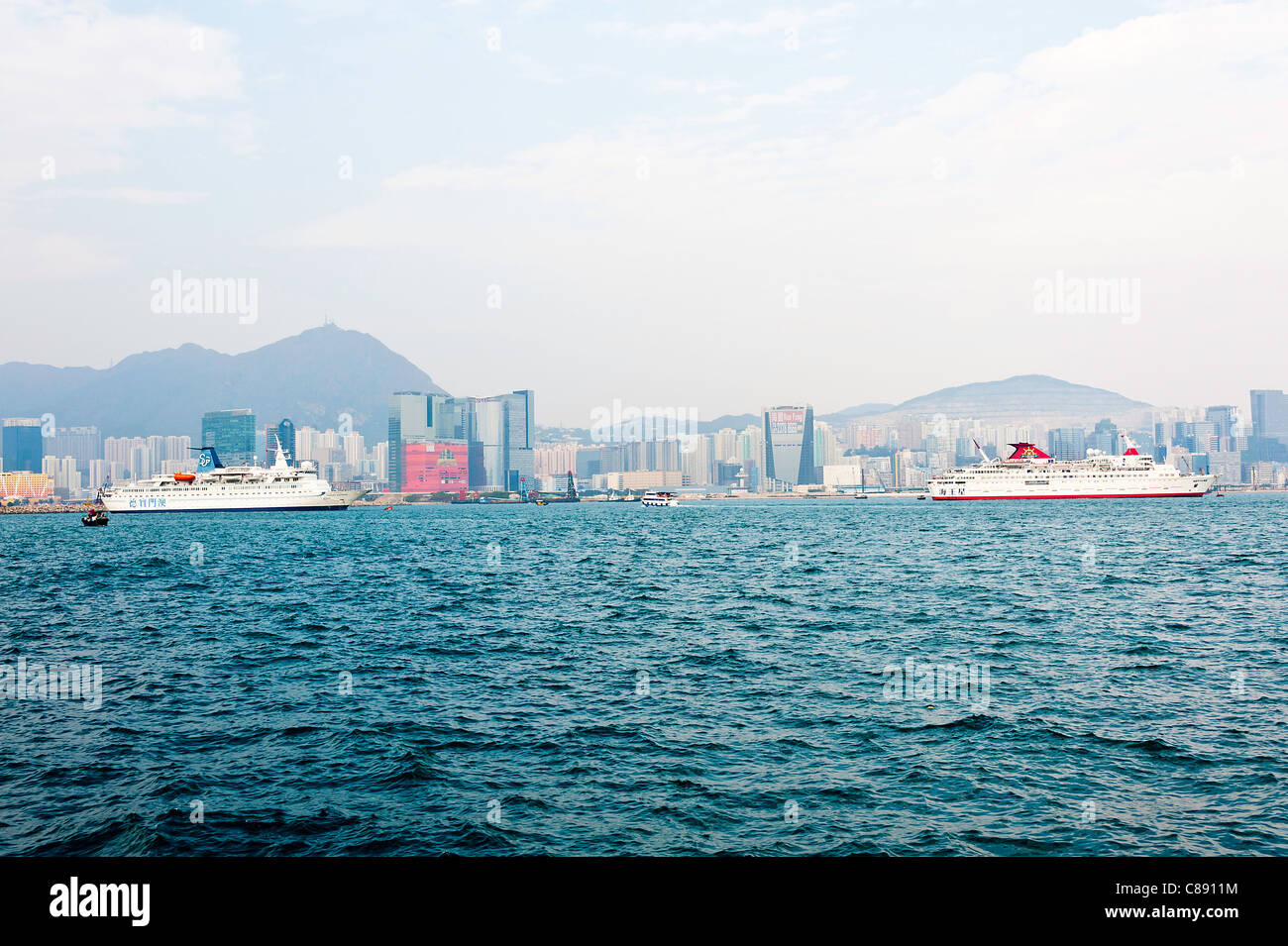 Cruise Ships Anchored in Victoria Harbour near Kowloon Hong Kong China Asia - Stock Image