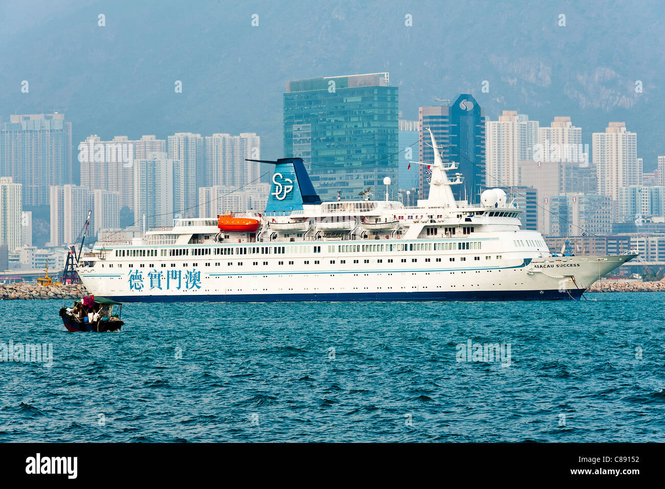 Cruise Ship Anchored in Victoria Harbour near Kowloon Hong Kong China Asia - Stock Image