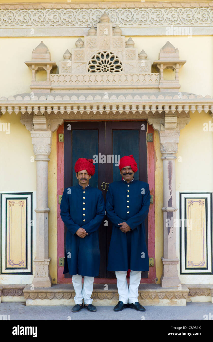 Palace guards in achkan suit at former Royal Guest House in the Maharaja's Moon Palace in Jaipur, Rajasthan, - Stock Image