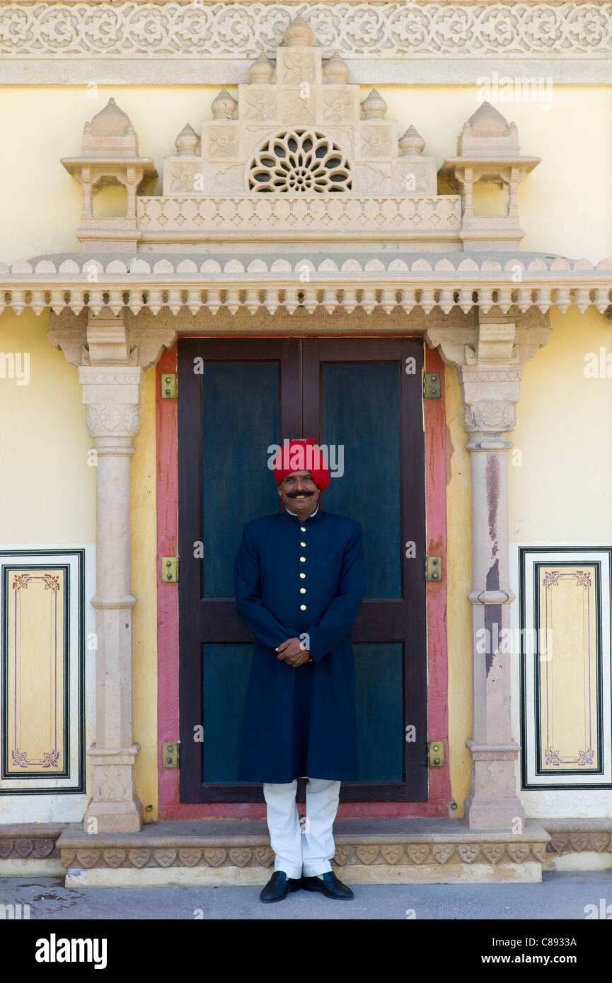Palace guard in achkan suit at former Royal Guest House now textile museum in Maharaja's Moon Palace, Jaipur, - Stock Image