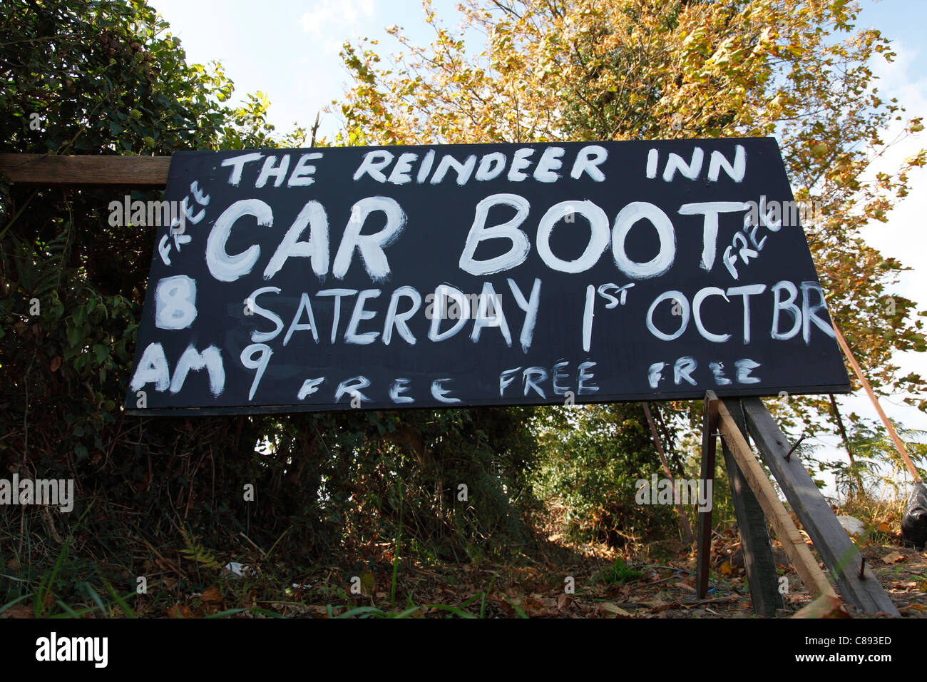 Incorrect spelling on a roadside sign advertising a car boot sale in the U.K. - Stock Image