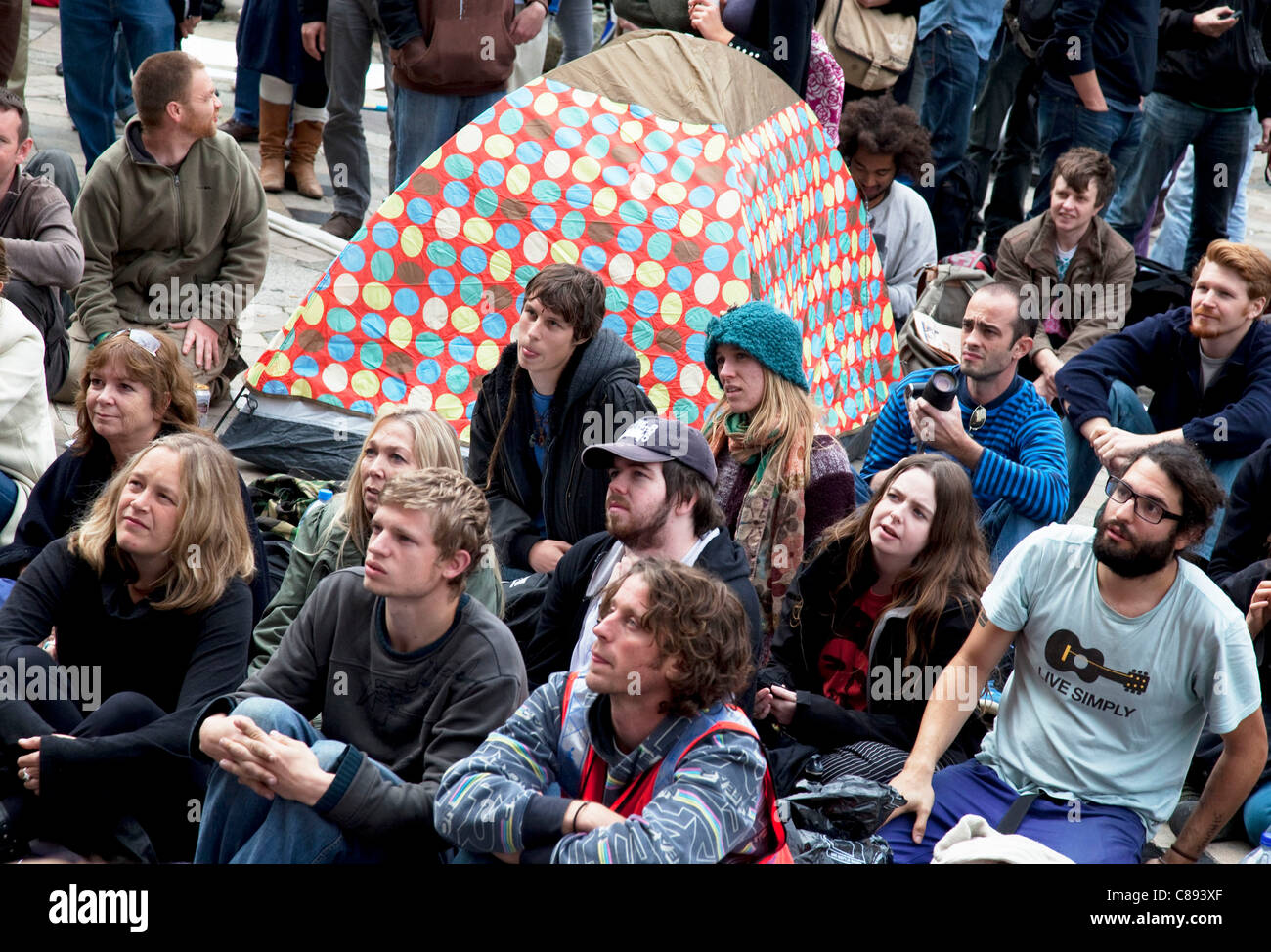 People gathered listening to speakers. Occupy London protest at St Pauls, October 16th 2011. Protest spreads from - Stock Image