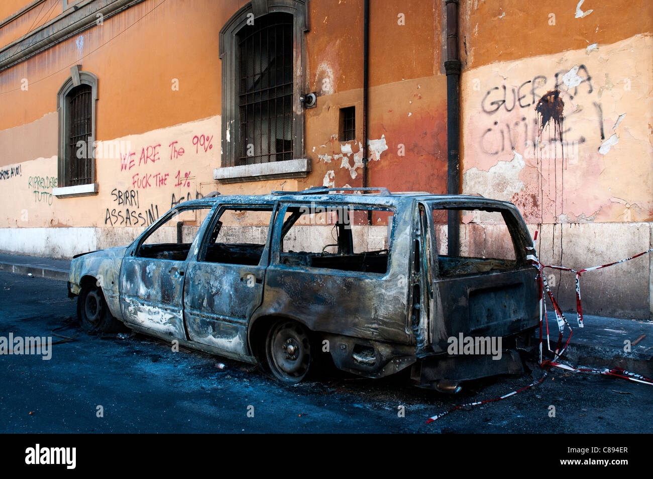 ROME, Italy, 16/10/2011 Torched car after black bloc rampage during the global 'Day of Rage' - Stock Image