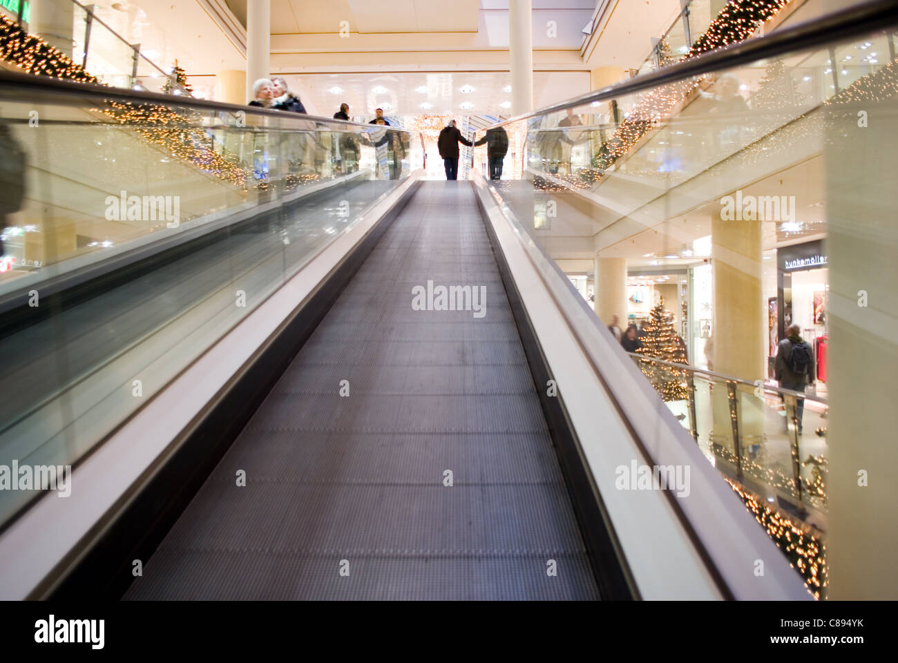 Christmas shopping mall stairways decorated with lights - Stock Image
