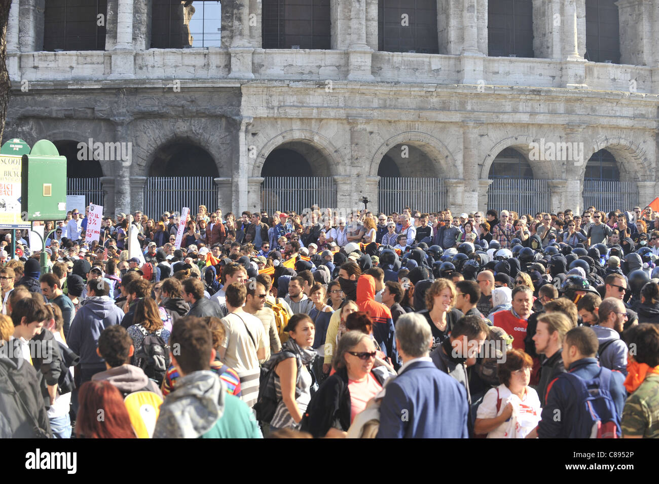 Black Bloc under the Colosseum. Indignants Protest in Rome turns violent - Stock Image