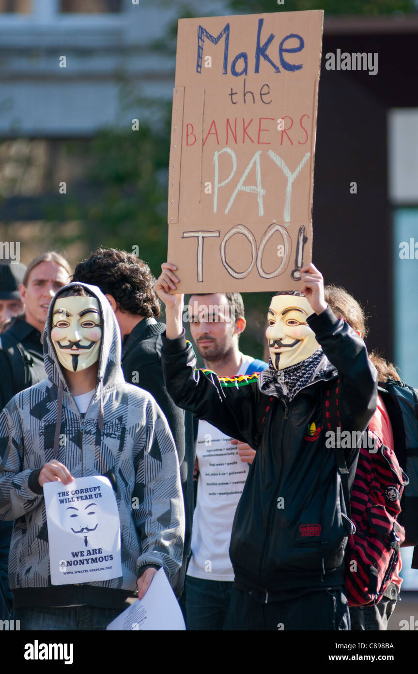 Masked demonstrators seen in Birmingham UK October 2011. Part of worldwide protest against banks and present economic - Stock Image