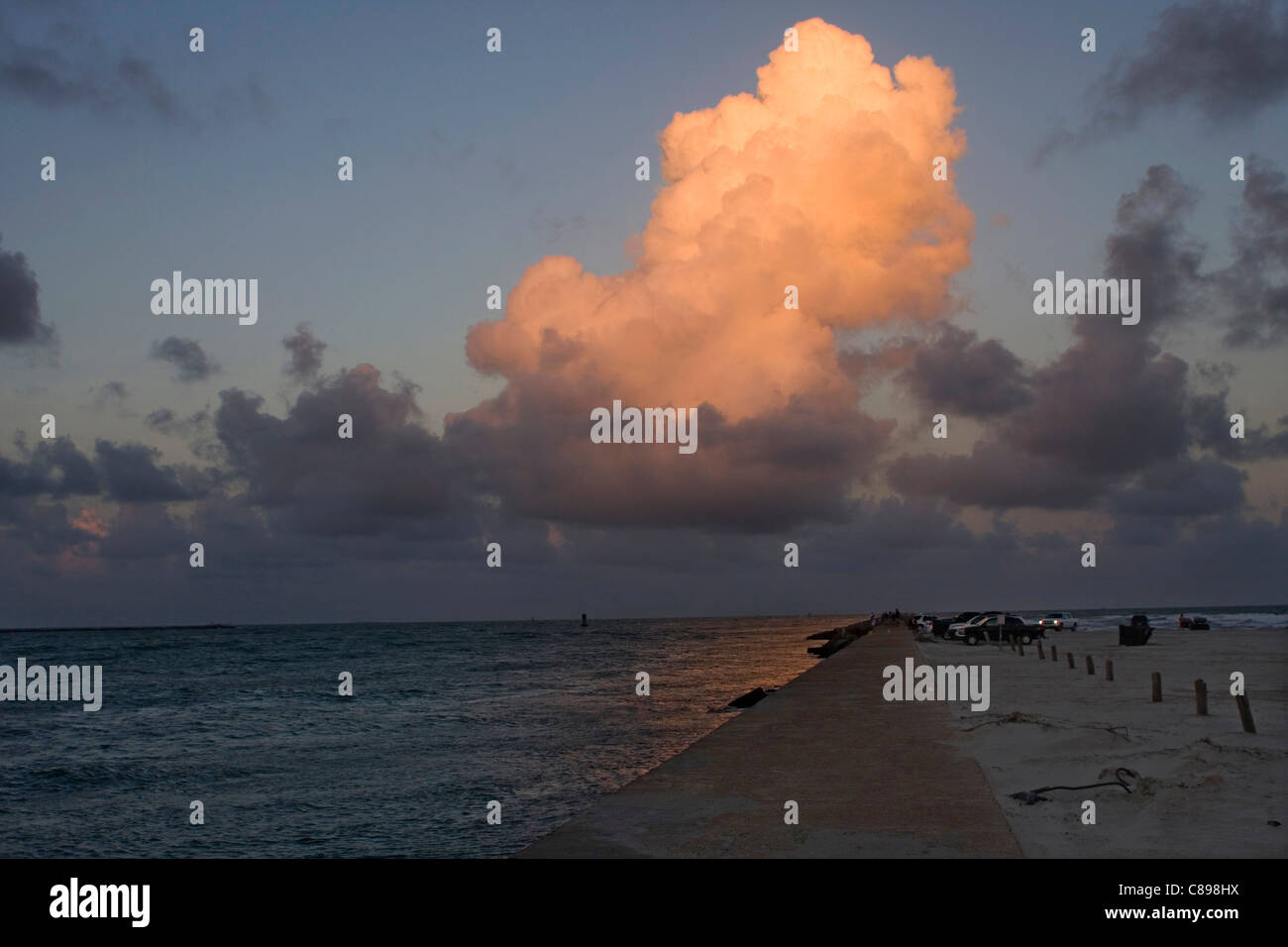 Dusk with cumulus cloud lite by sun at sunset in Port Aransas Texas USA Stock Photo