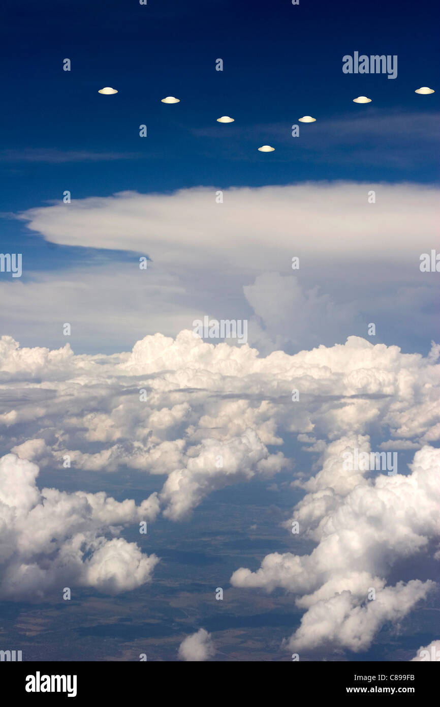 UFOs flying into storm - Stock Image