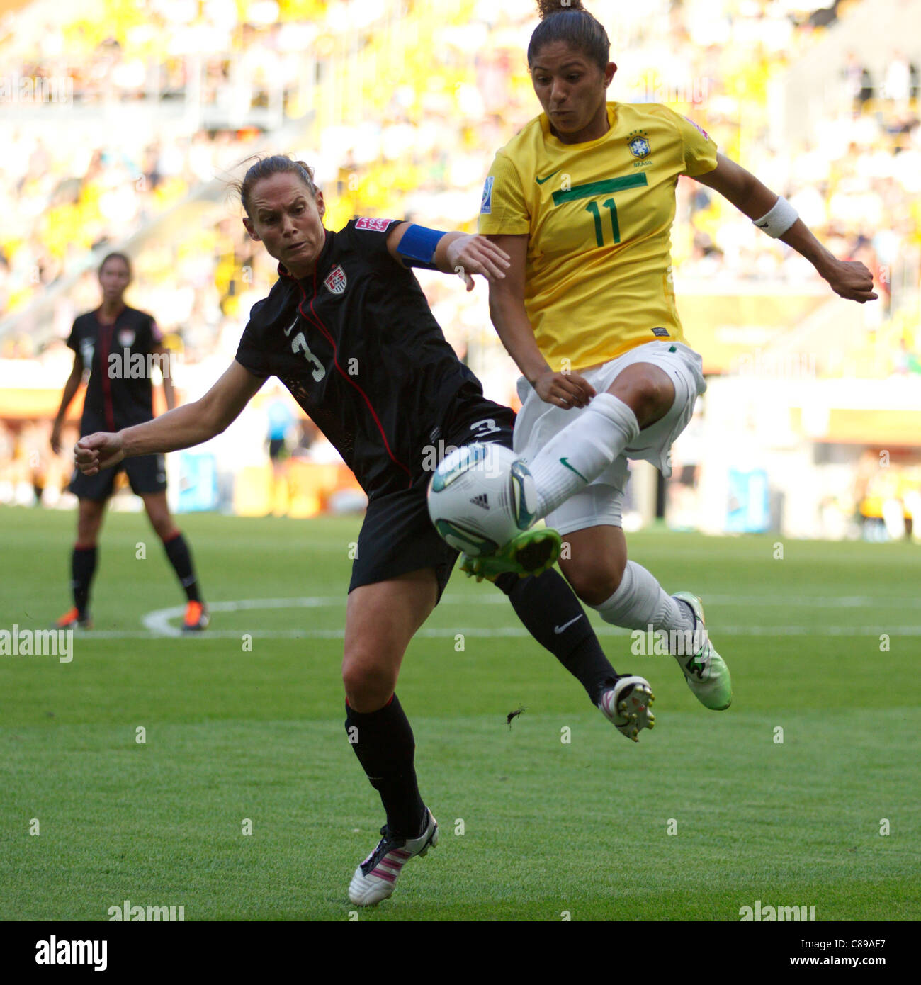 Cristiane of Brazil (R) kicks the ball ahead of Christie Rampone of the USA (L) during a 2011 Women's World - Stock Image