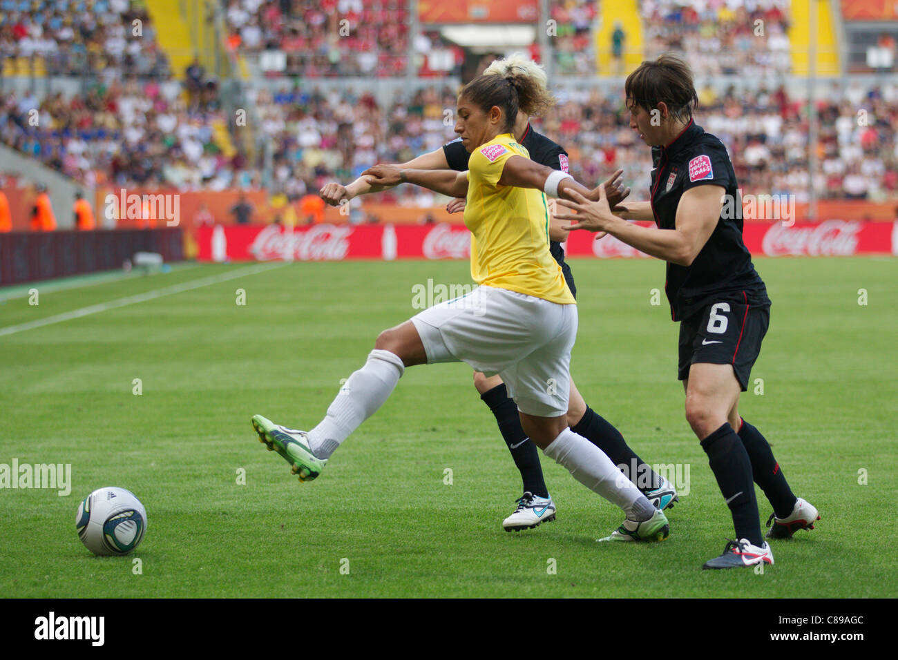 Cristiane of Brazil (L) stretches for the ball against Amy LePeilbet of the USA (R) during 2011 Women's World - Stock Image