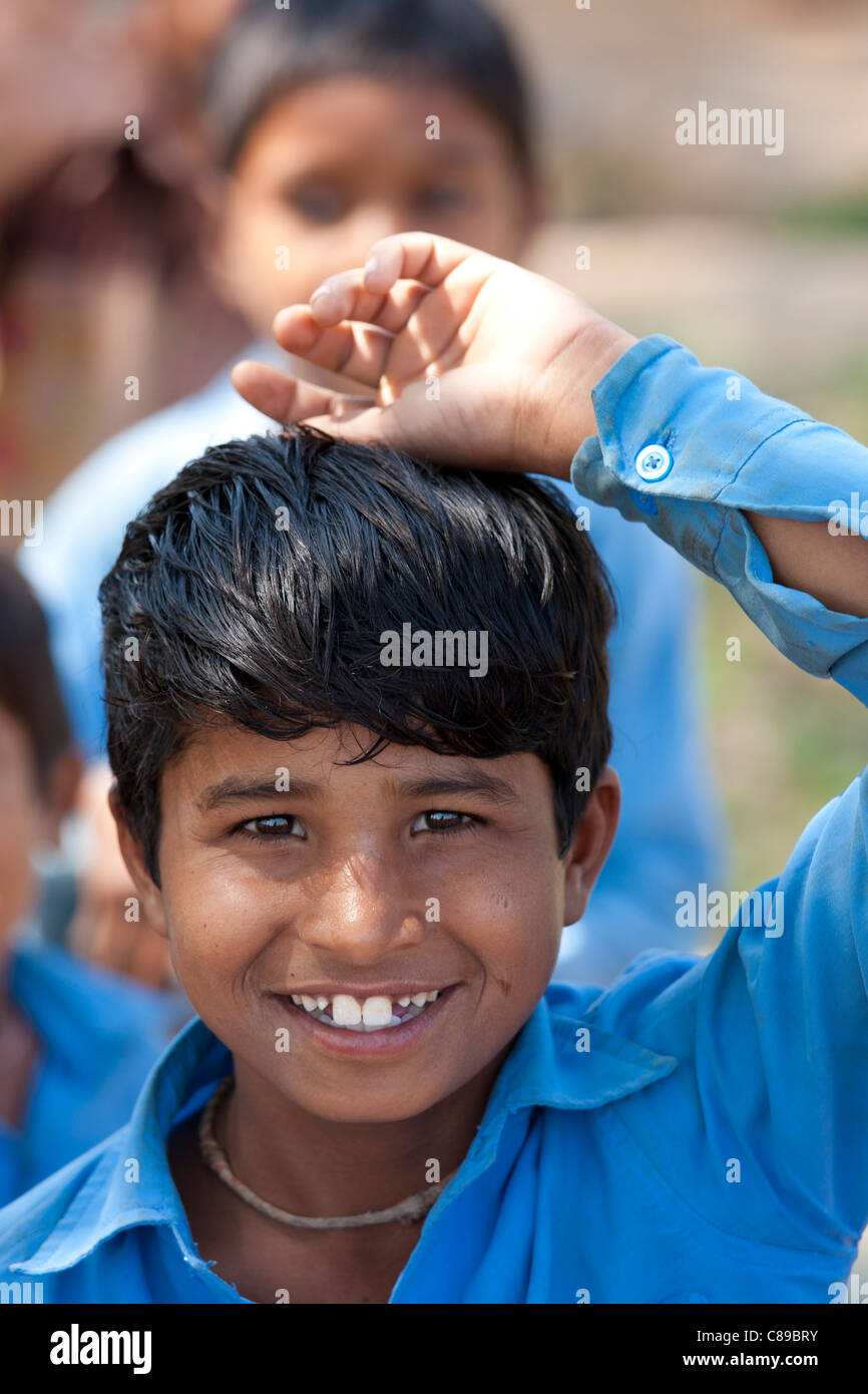 Indian schoolboy attending school at Doeli in Sawai Madhopur, Rajasthan, Northern India - Stock Image