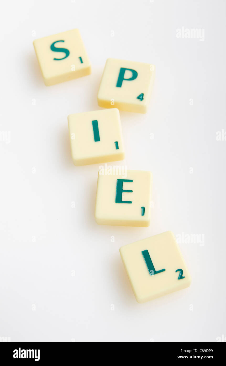 Scrabble game with word 'Spiel' on white background - Stock Image