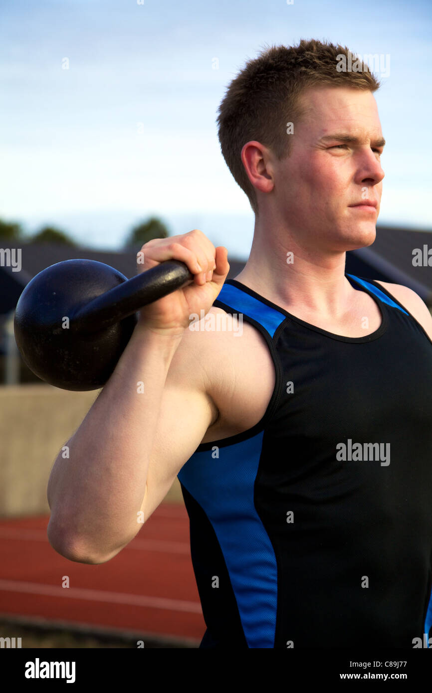Man working out with kettlebell. Shoulder exercise. Crossfit. - Stock Image