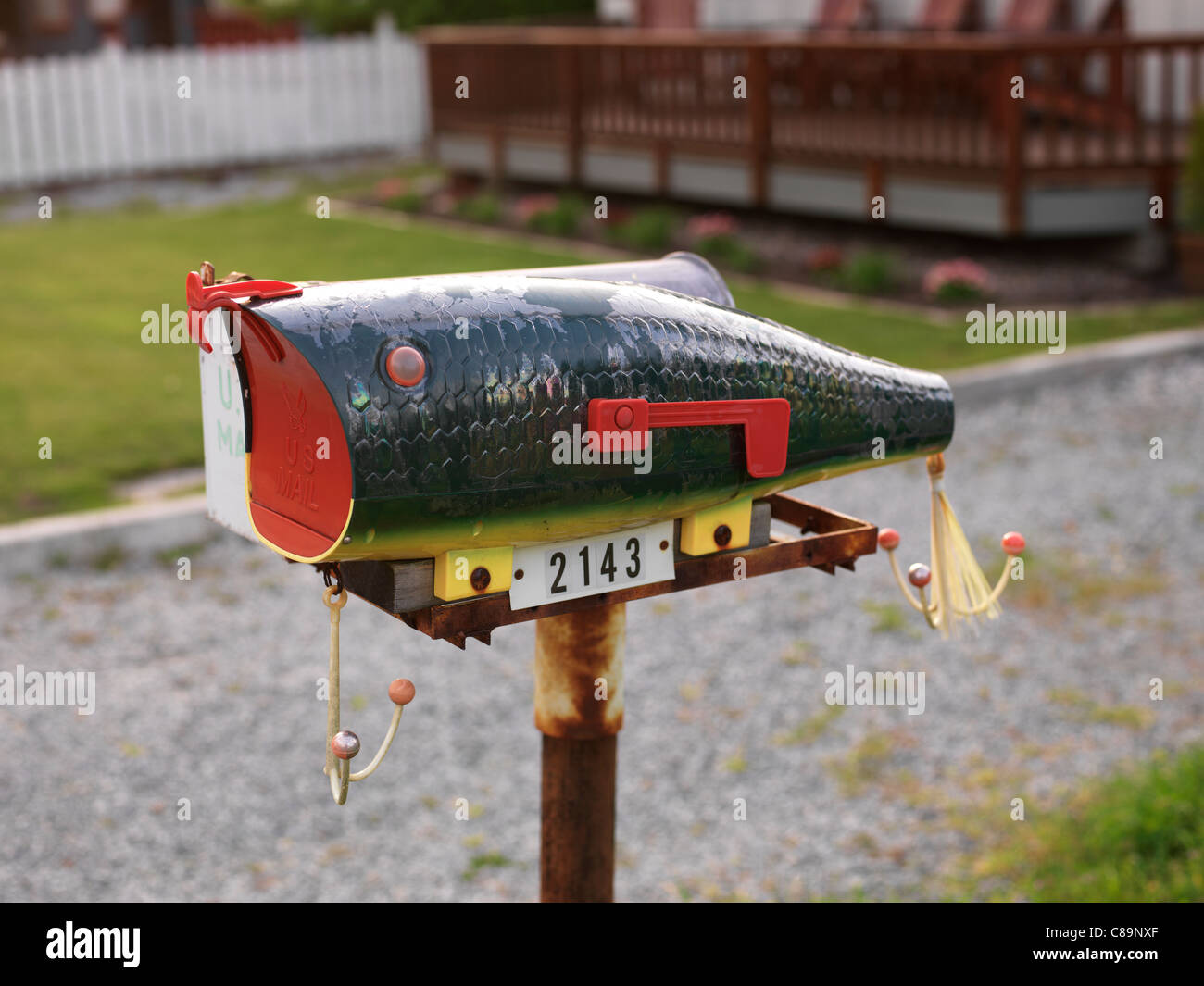 Mailbox shaped like a fish - Stock Image