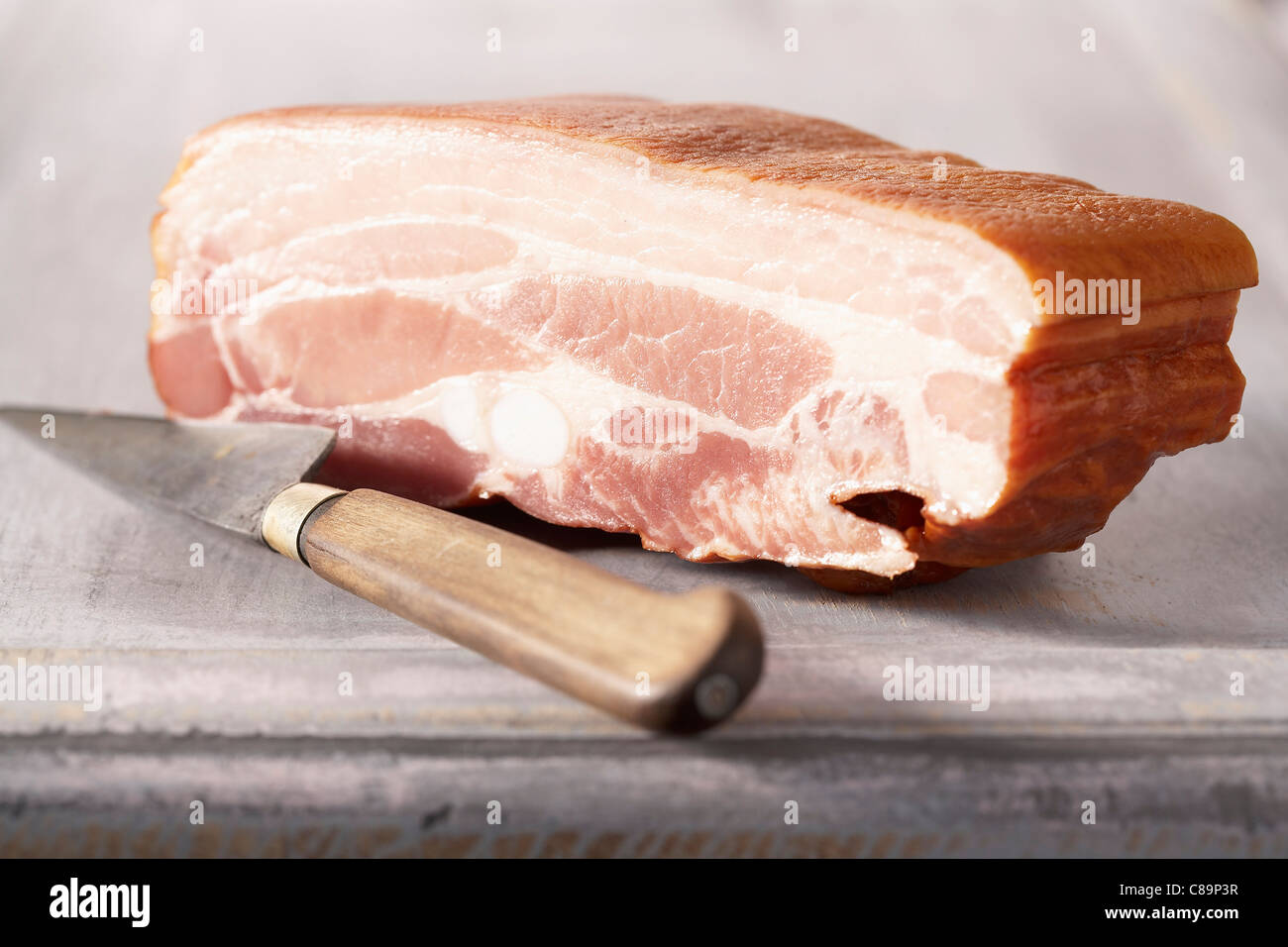 Thick piece of bacon - Stock Image