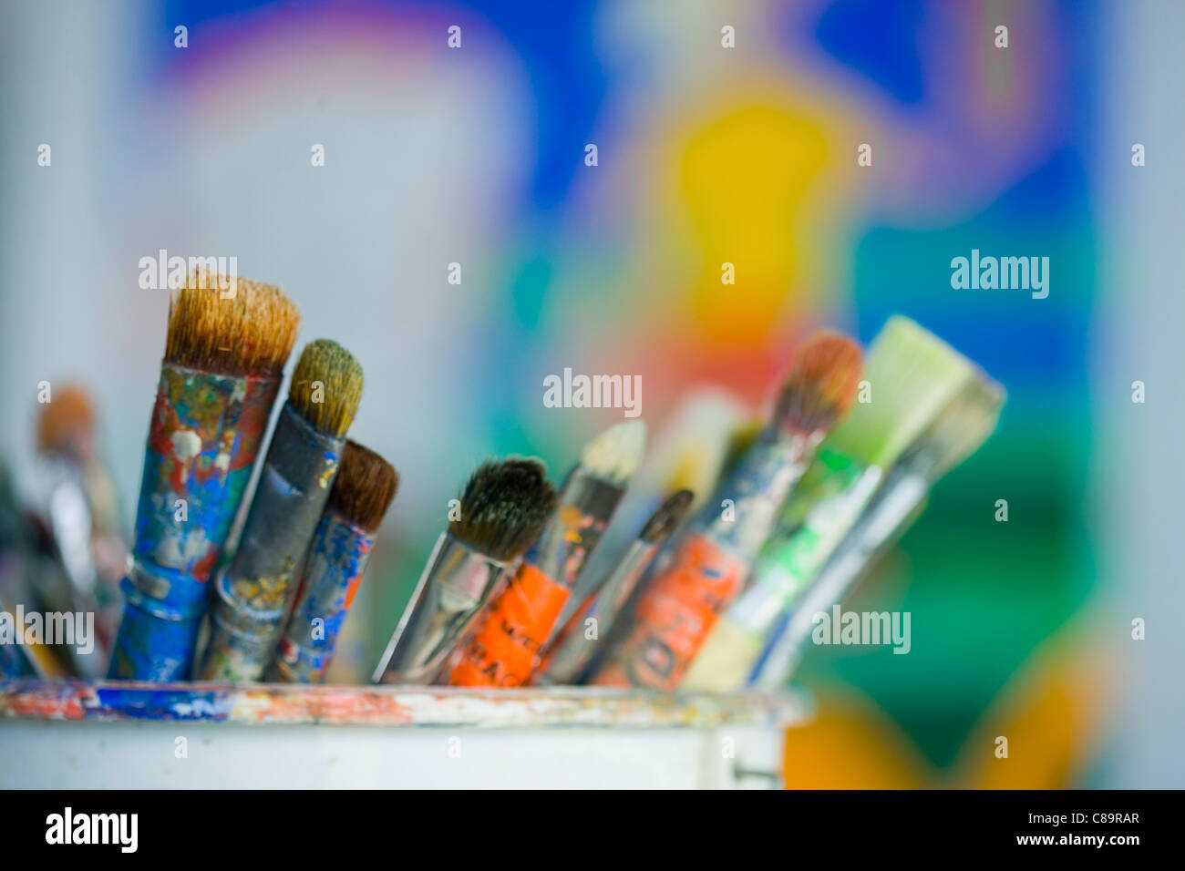 Close up of dirty paint brushes - Stock Image