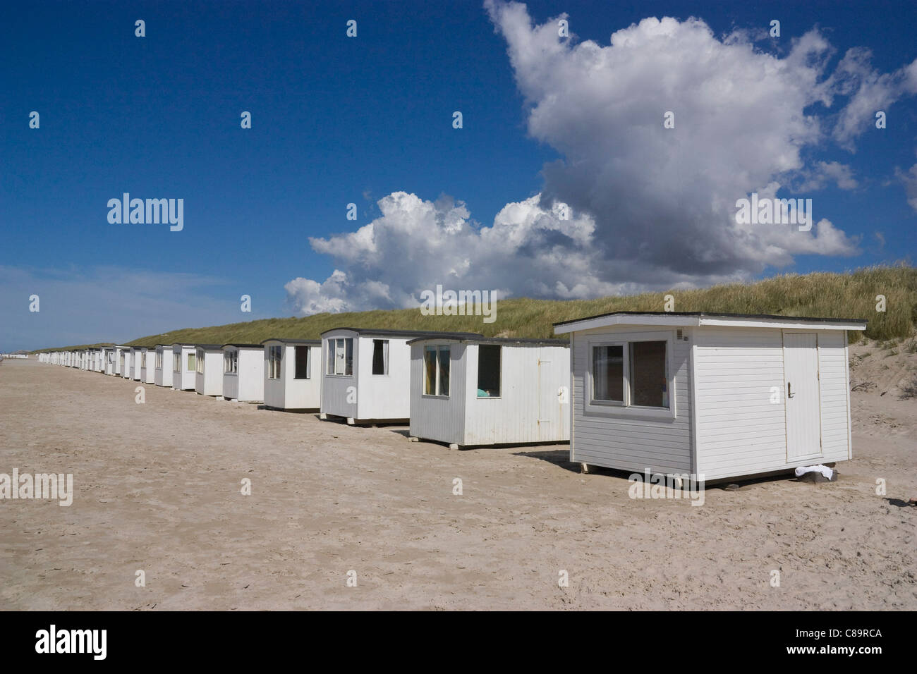 Denmark, View of dressing cabins lined up on beach - Stock Image