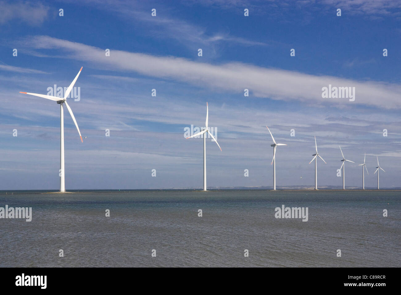 Denmark, Harbore, View of wind turbines at coast - Stock Image