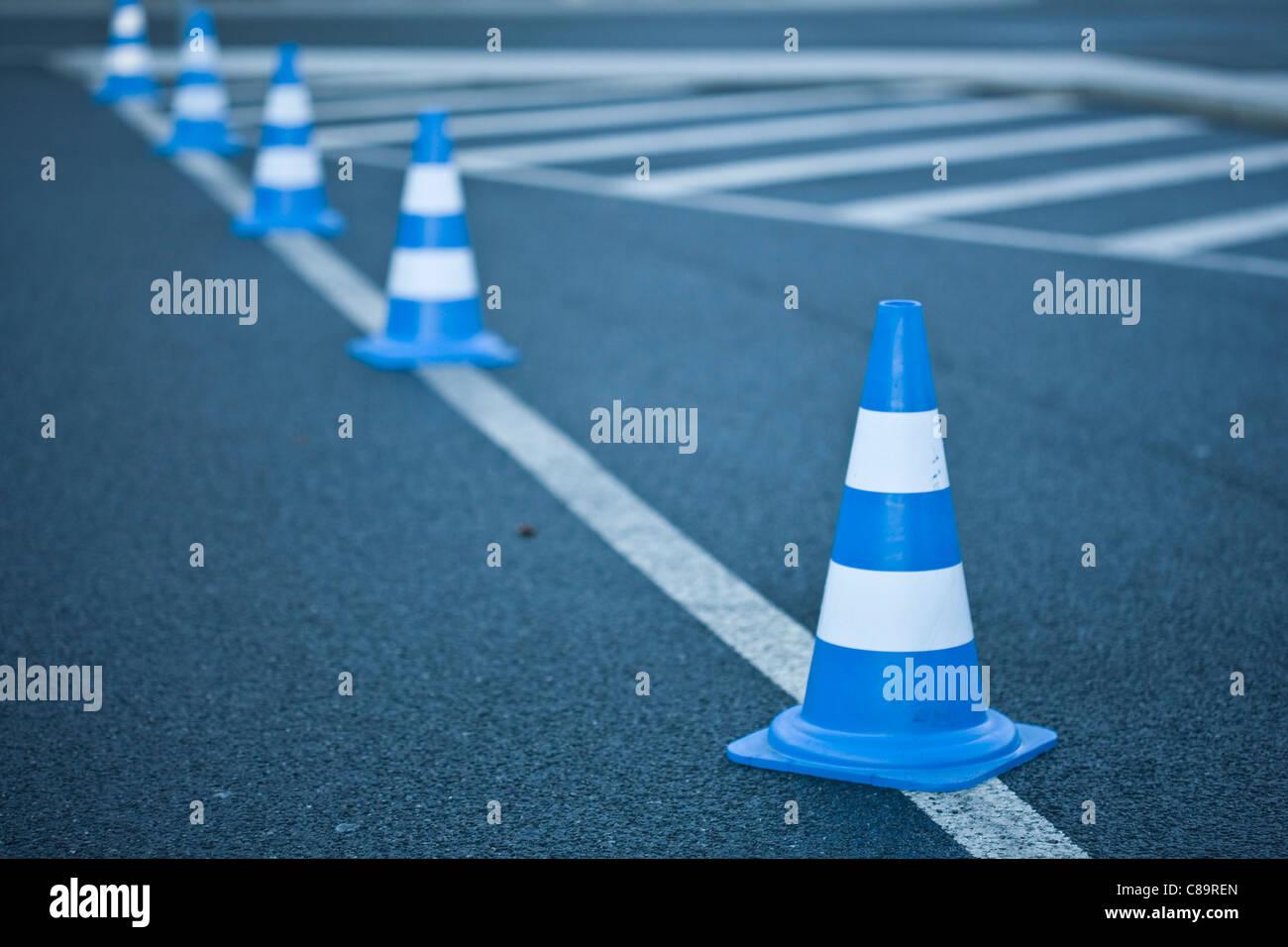 Germany, Wolfsburg, Traffic cones on road marking - Stock Image
