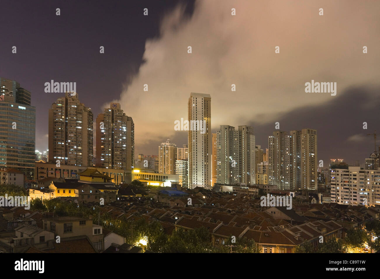 China, Shanghai, View of skyscrapers in city at night - Stock Image
