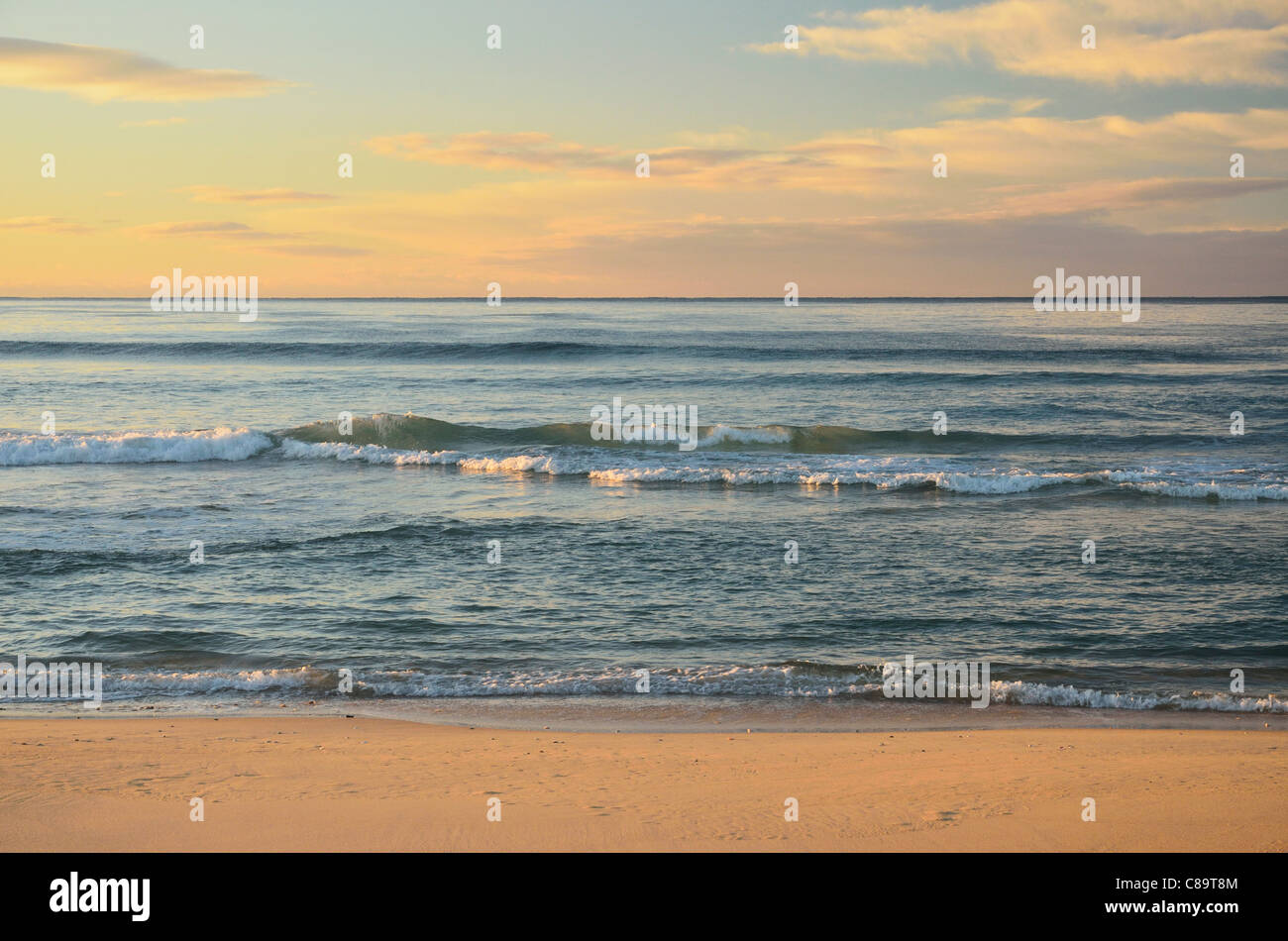 Australia, New South Wales, Bermagui, View of beach at dusk - Stock Image