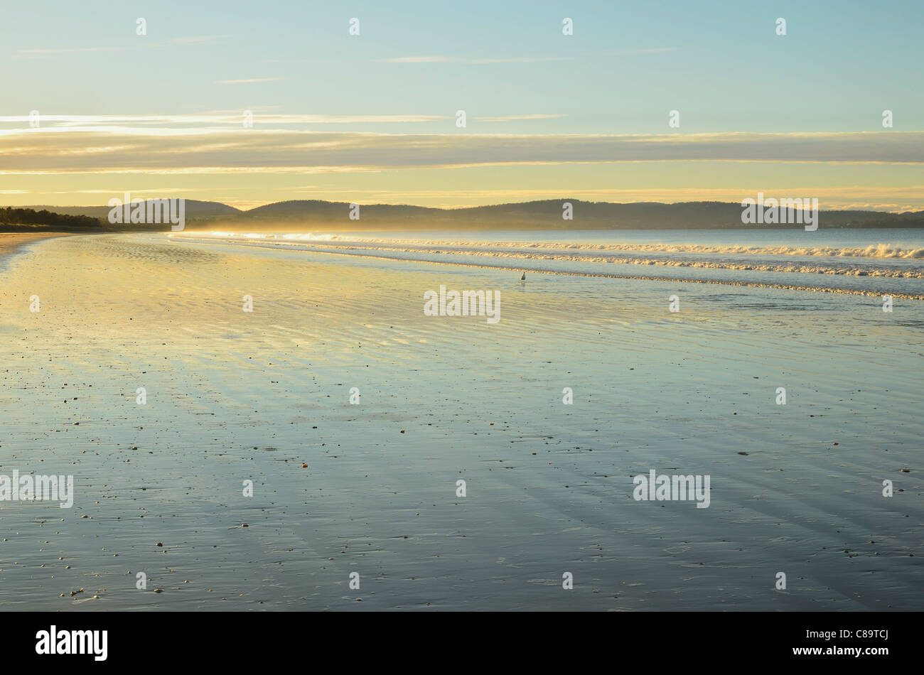 Australia, Tasmania, Seven Mile Beach Protected Area, Seven Mile Beach, View of Frederick Henry Bay at dawn - Stock Image