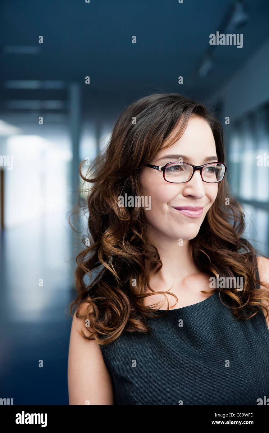 Germany, Bavaria, Diessen am Ammersee, Close up of businesswoman in thick spectacles, smiling - Stock Image