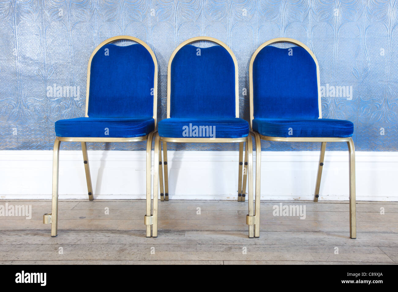 Chairs lined up neatly in the Miners Welfare Club in Horden, County Durham, England - Stock Image