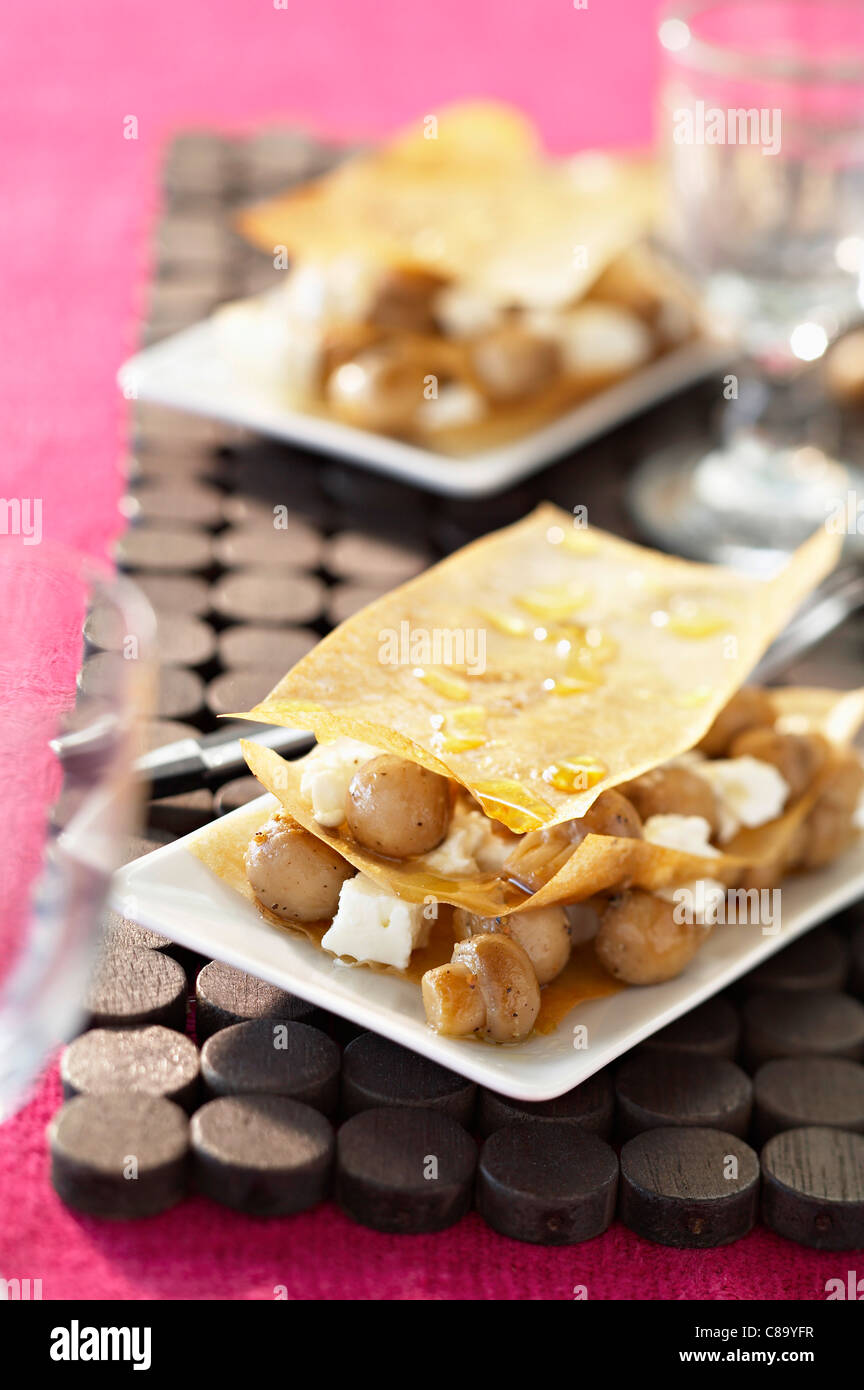Button mushroom and feta filo pastry starter - Stock Image