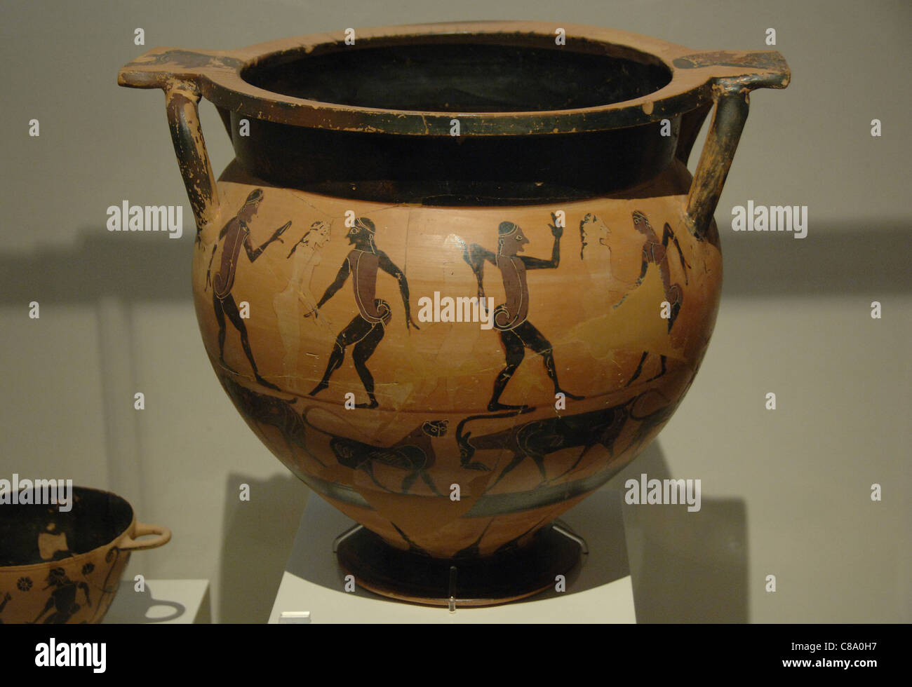 Greek Art. Archaic period. Krater painted with scenes of men and women dancing. - Stock Image