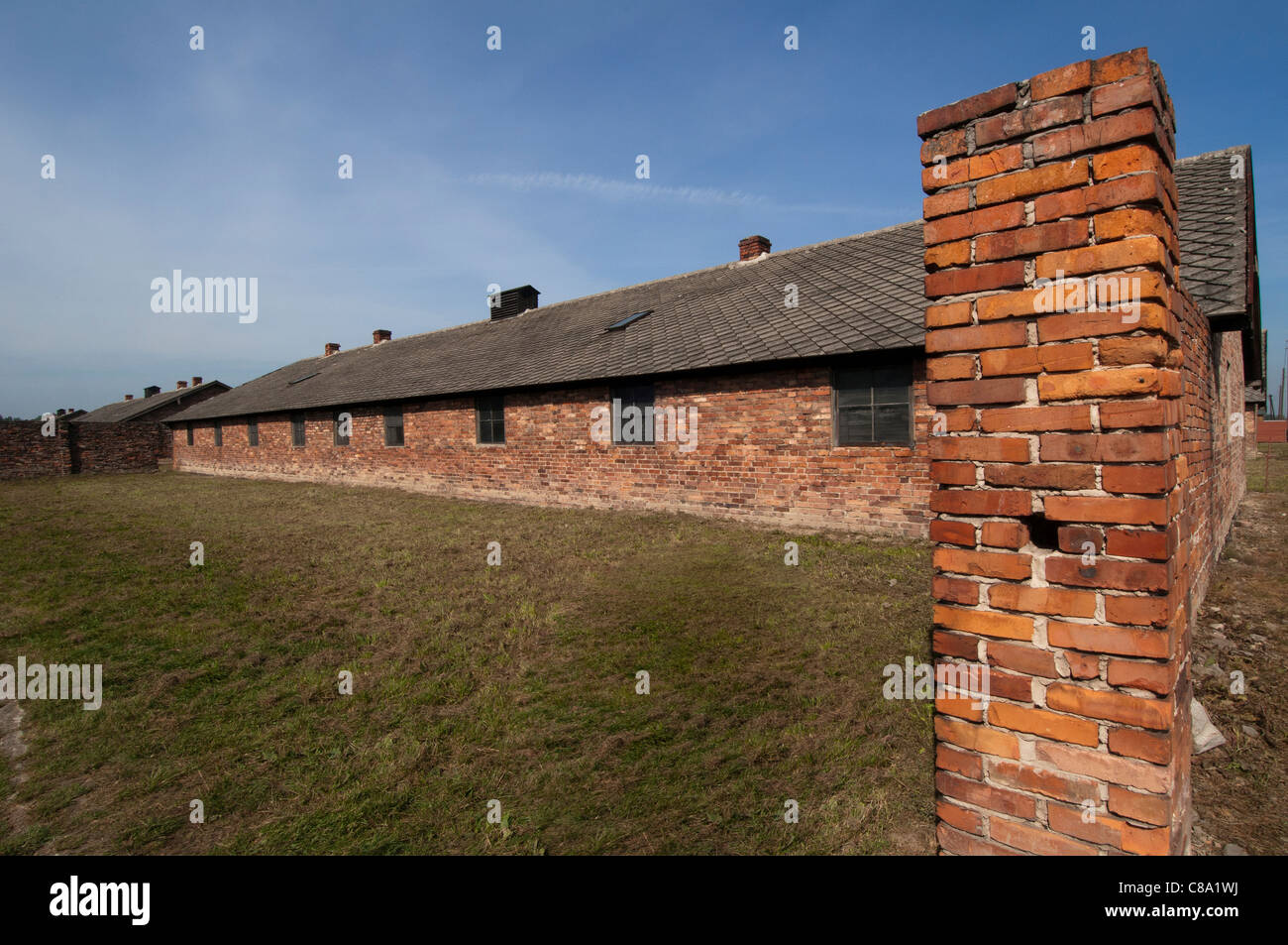 Auschwitz II - Birkenau concentration and extermination camp, Oswiceim, Poland. External shot of inmates' barracks - Stock Image