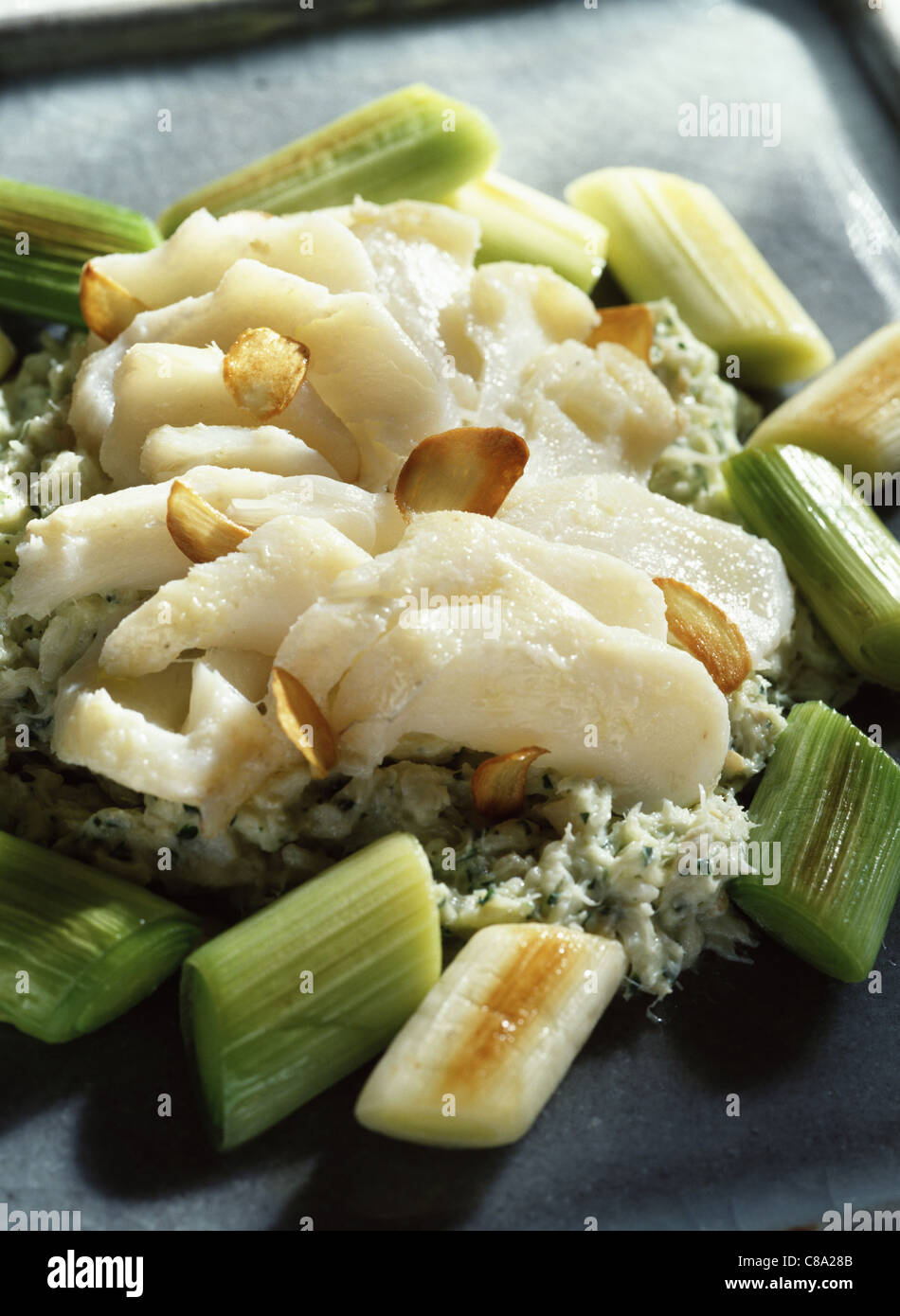 Cod with preserved leeks - Stock Image