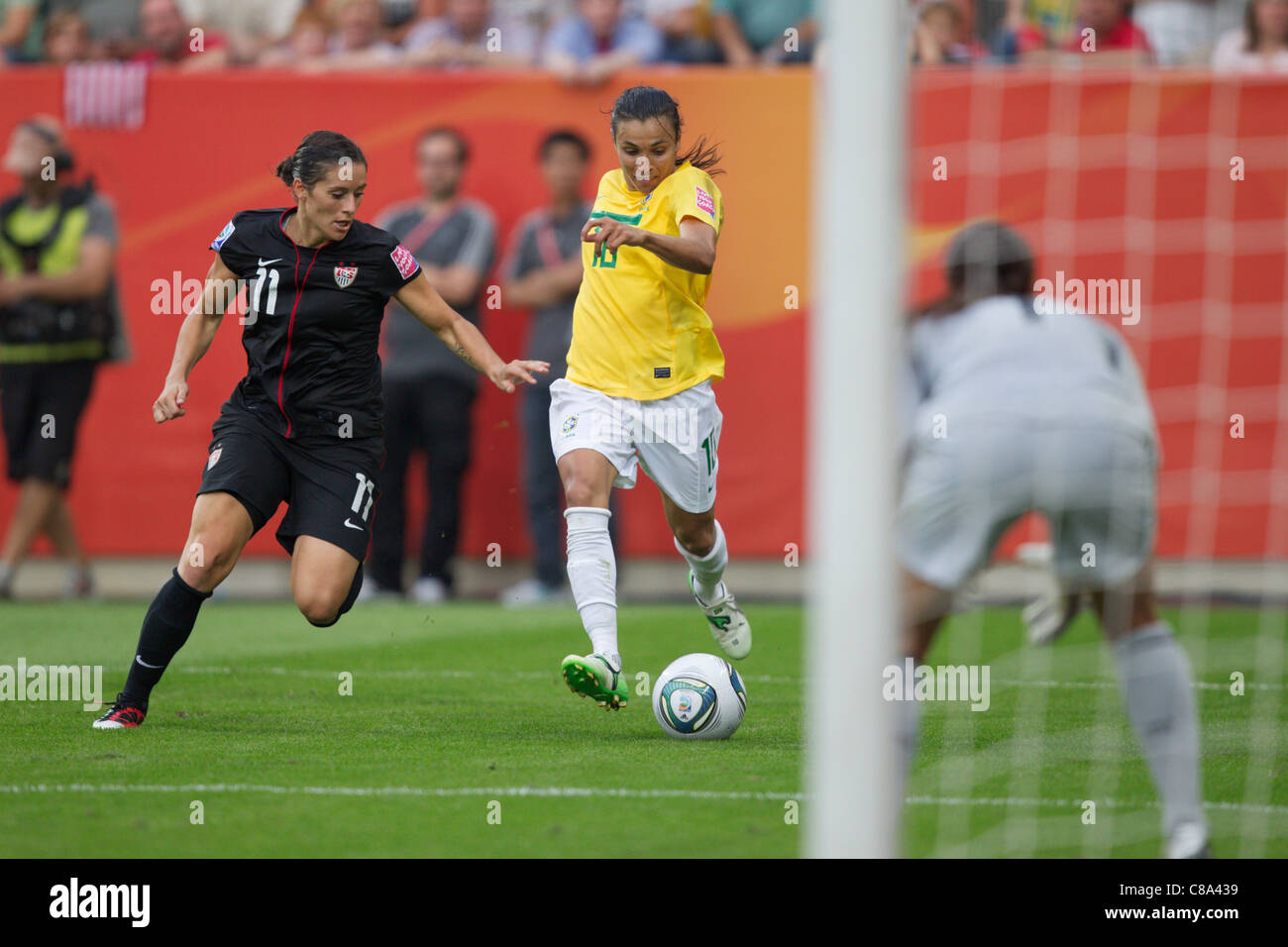 Marta of Brazil (R) drives the ball against Alex Krieger of the United States (L) during a Women's World Cup - Stock Image