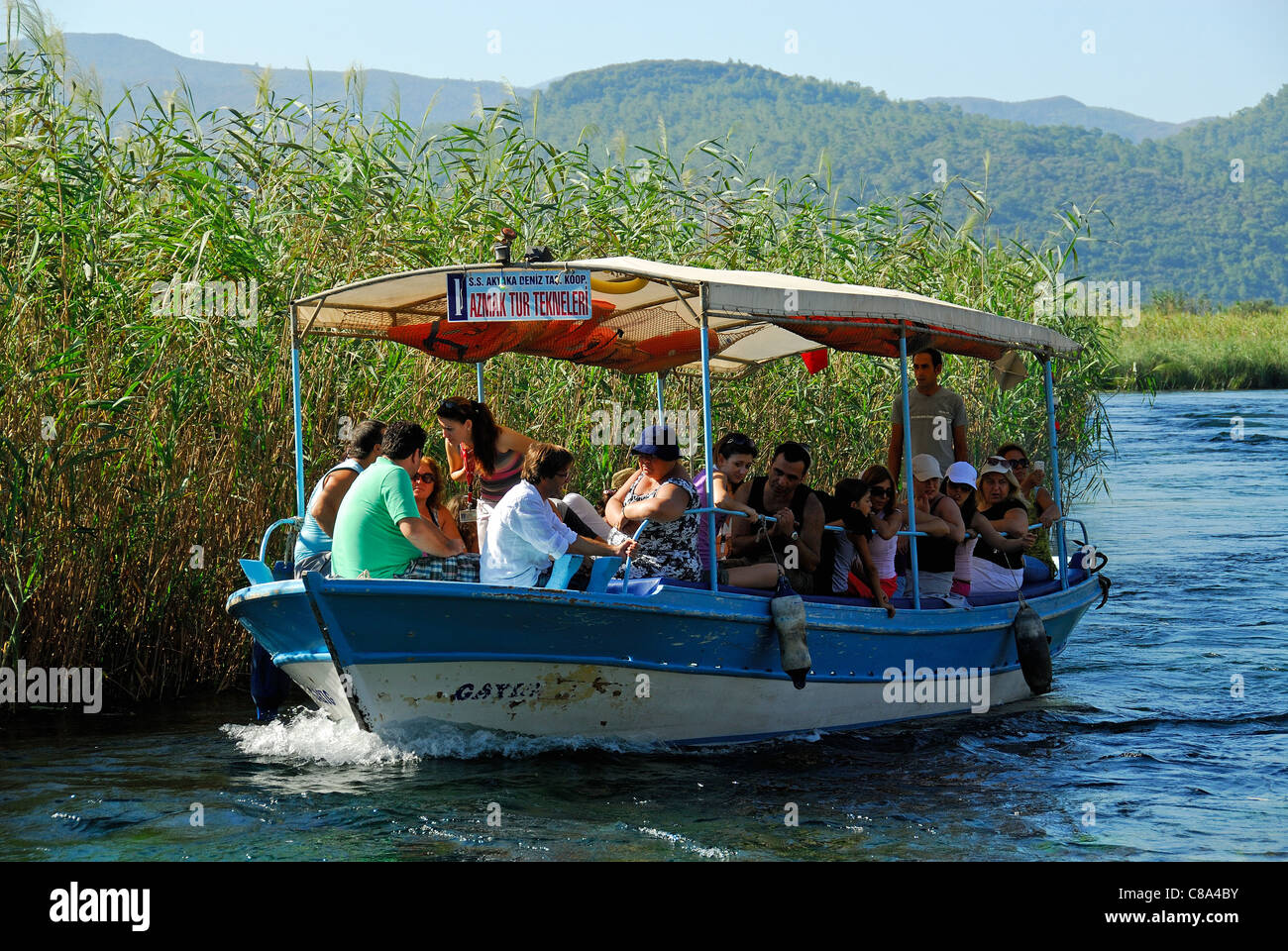 AKYAKA, TURKEY. A pleasure boat taking holidaymakers along the Azmak river in the Gokova conservation area. 2011. Stock Photo