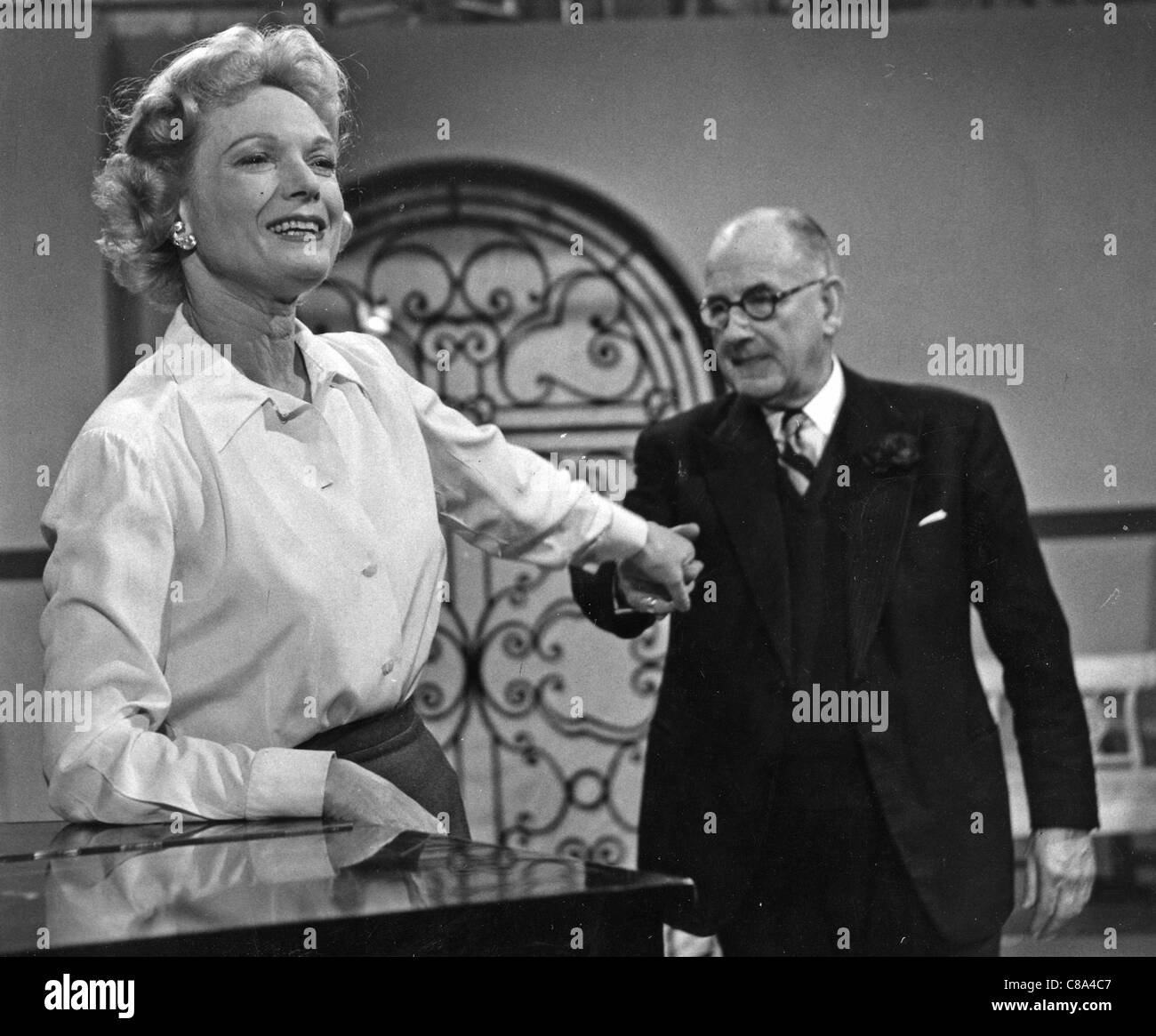 ANNA NEAGLE (1904-1986) English stage and film actress with husband Herbert Wilcox about 1954 - Stock Image