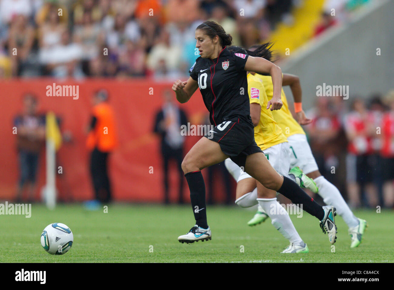 Carli Lloyd of the United States races for the ball during a 2011 FIFA Women's World Cup quarterfinal match - Stock Image