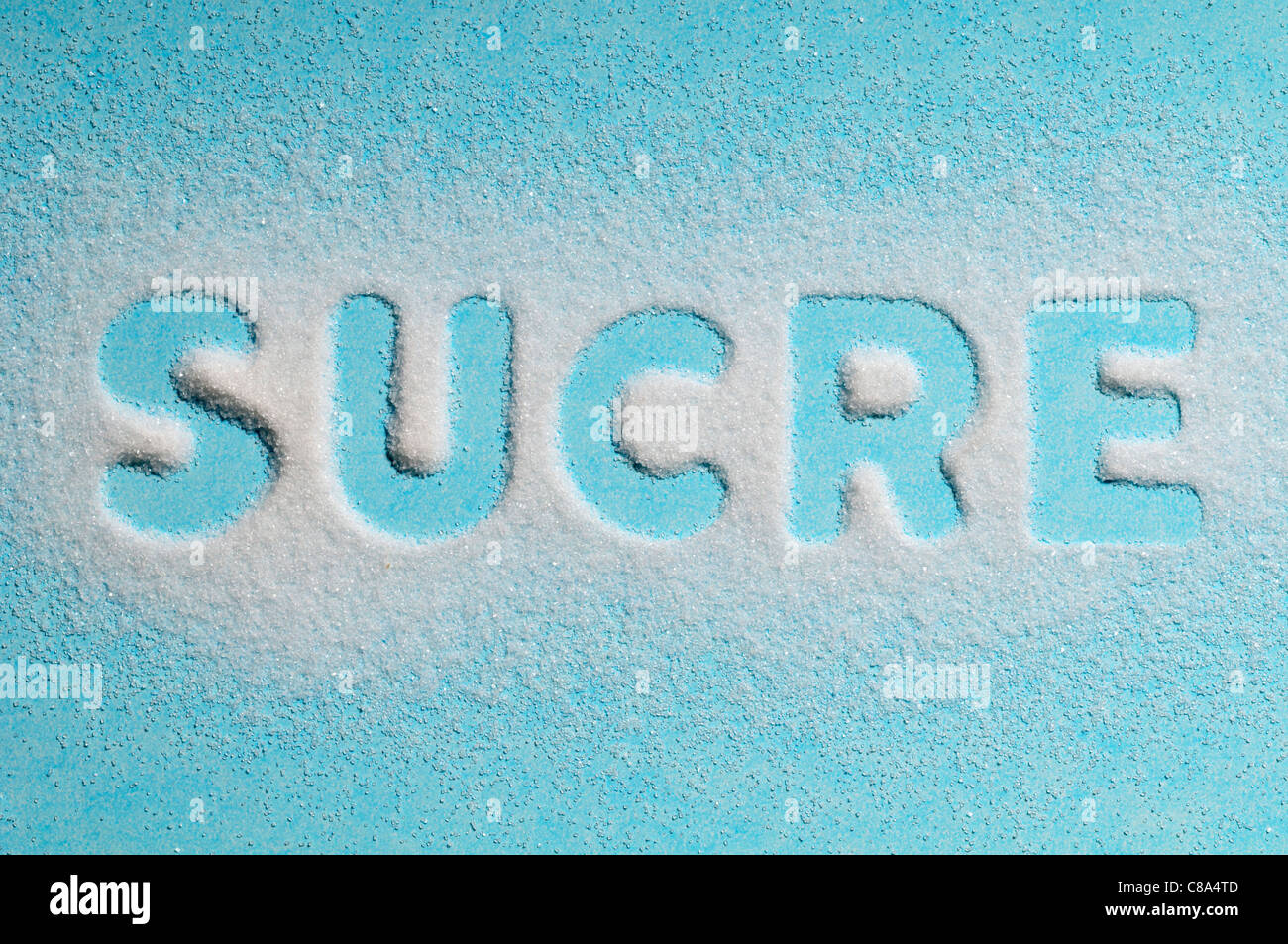 The word 'sucre' written with sugar - Stock Image