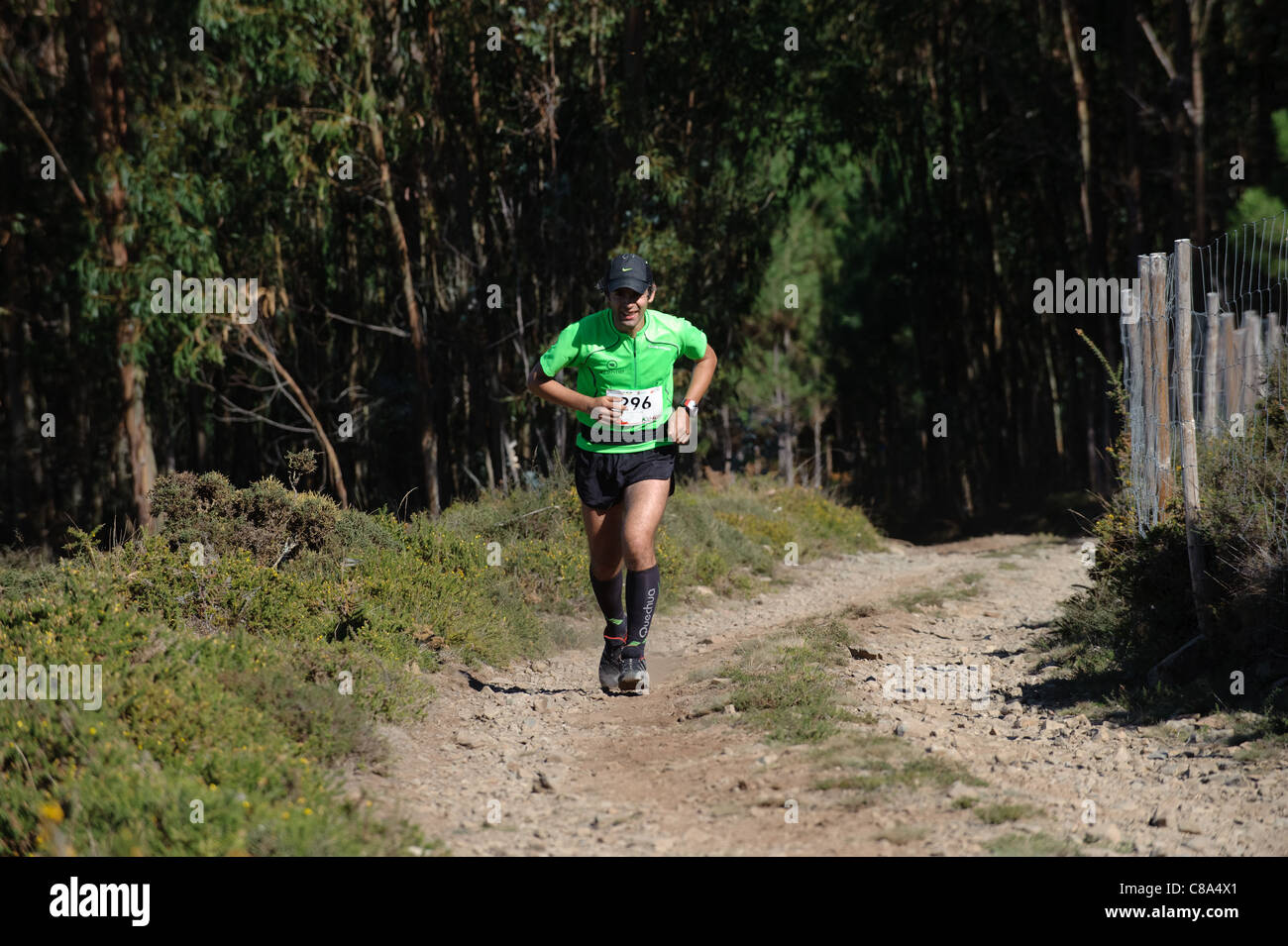 Man running in cross country trail race - Stock Image