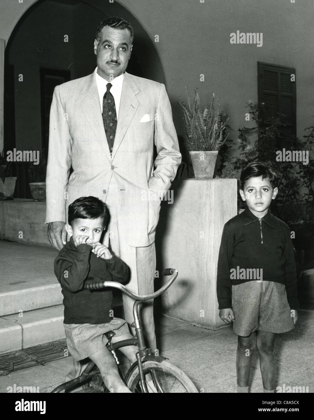 GAMAL ABDEL NASSER (1918-1970) second President of Egypt with two of his three sons - Stock Image