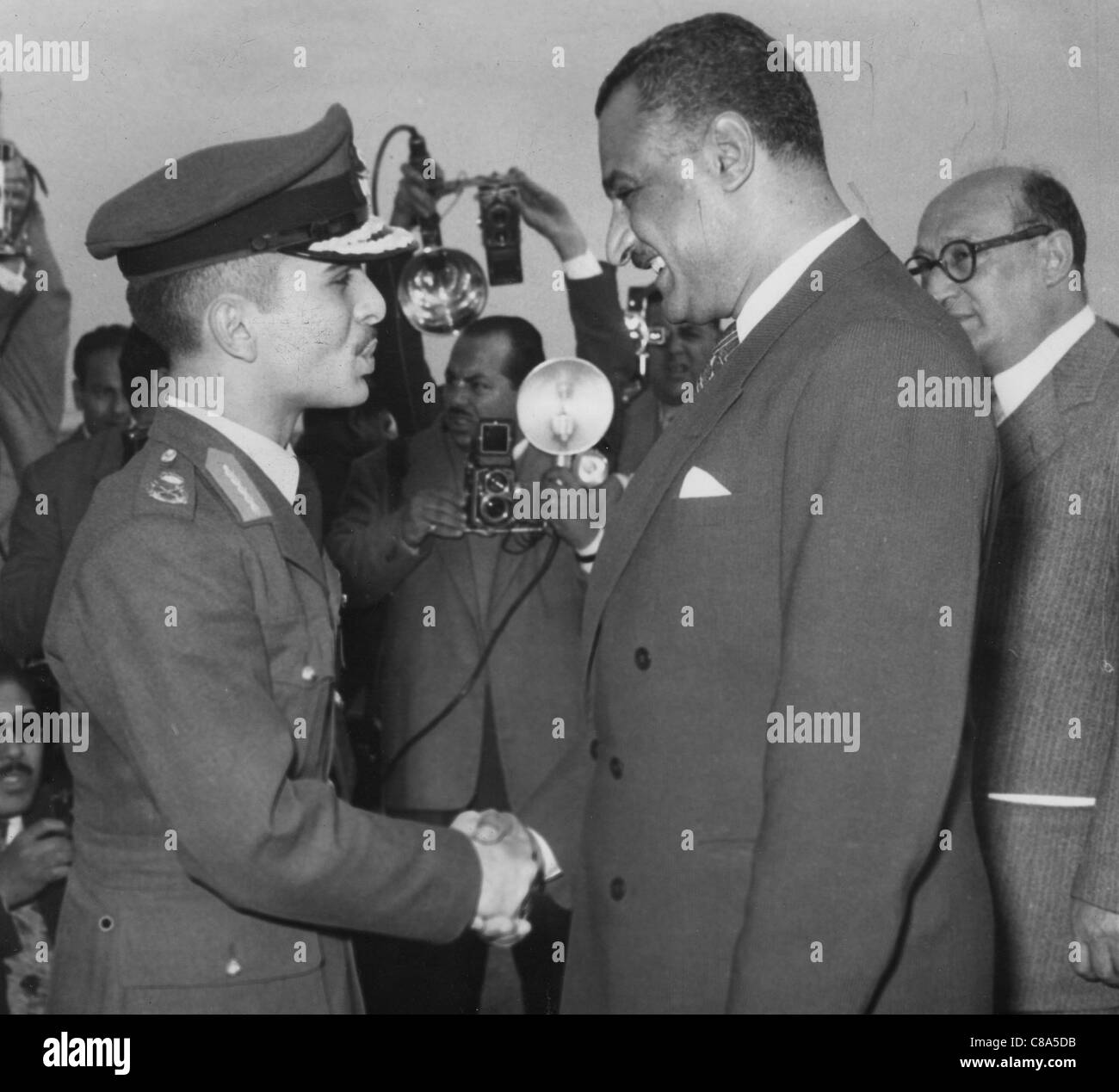 GAMAL ABDEL NASSER (1918-1970) second President of Egypt at right with King Hussein of Jordan - Stock Image