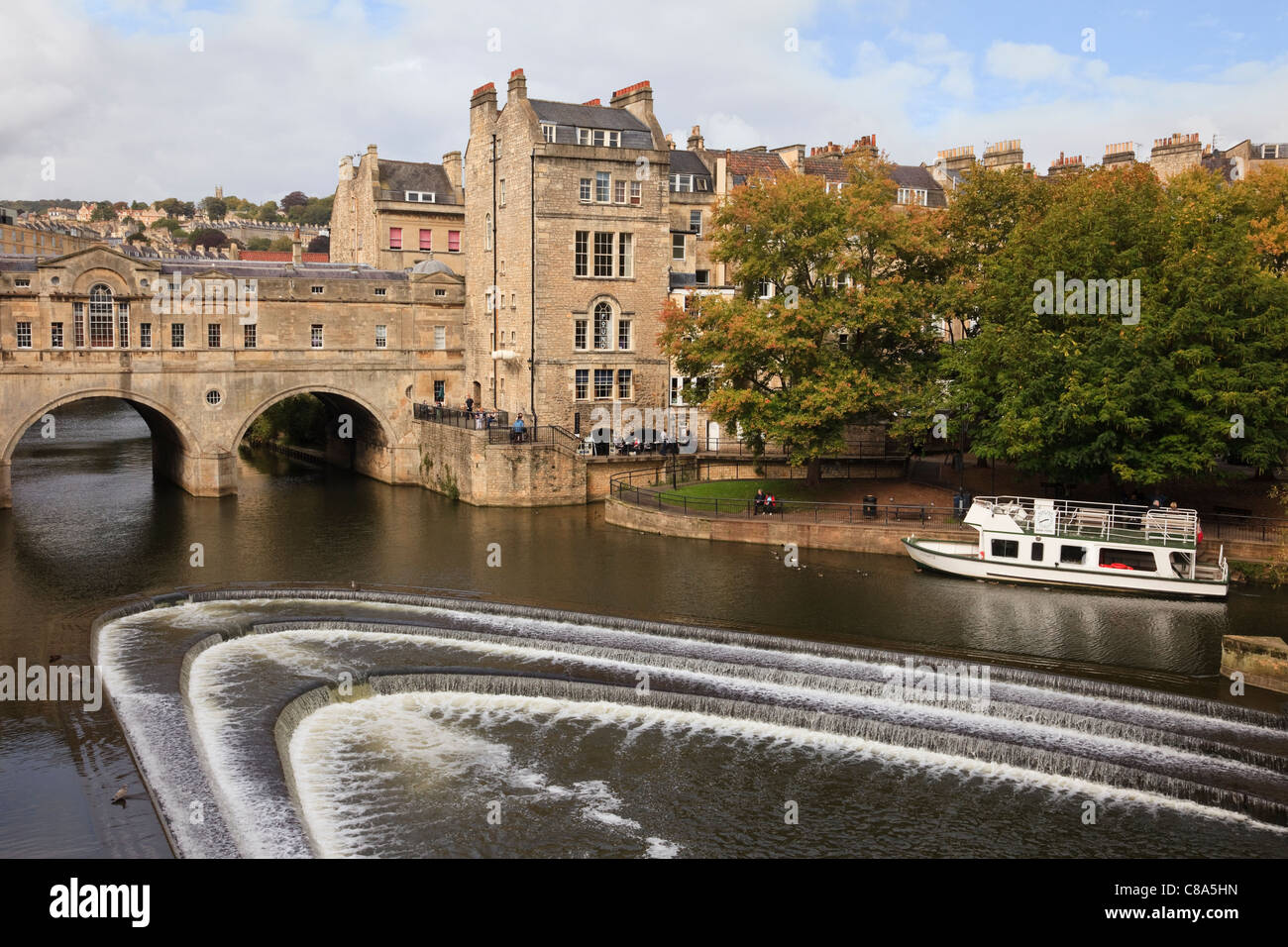 Horseshoe weir on the River Avon by Pulteney Bridge with shops on both sides Bath Somerset England UK Great Britain. - Stock Image