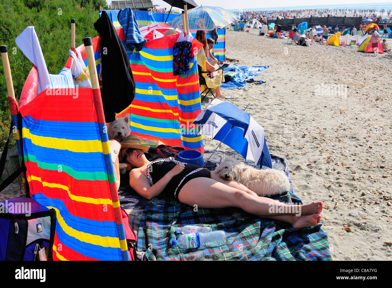 Crowds sunbathing on West Wiittering beach during the unusualy hot weekend  of 1st 2nd October 2011 - Stock Image