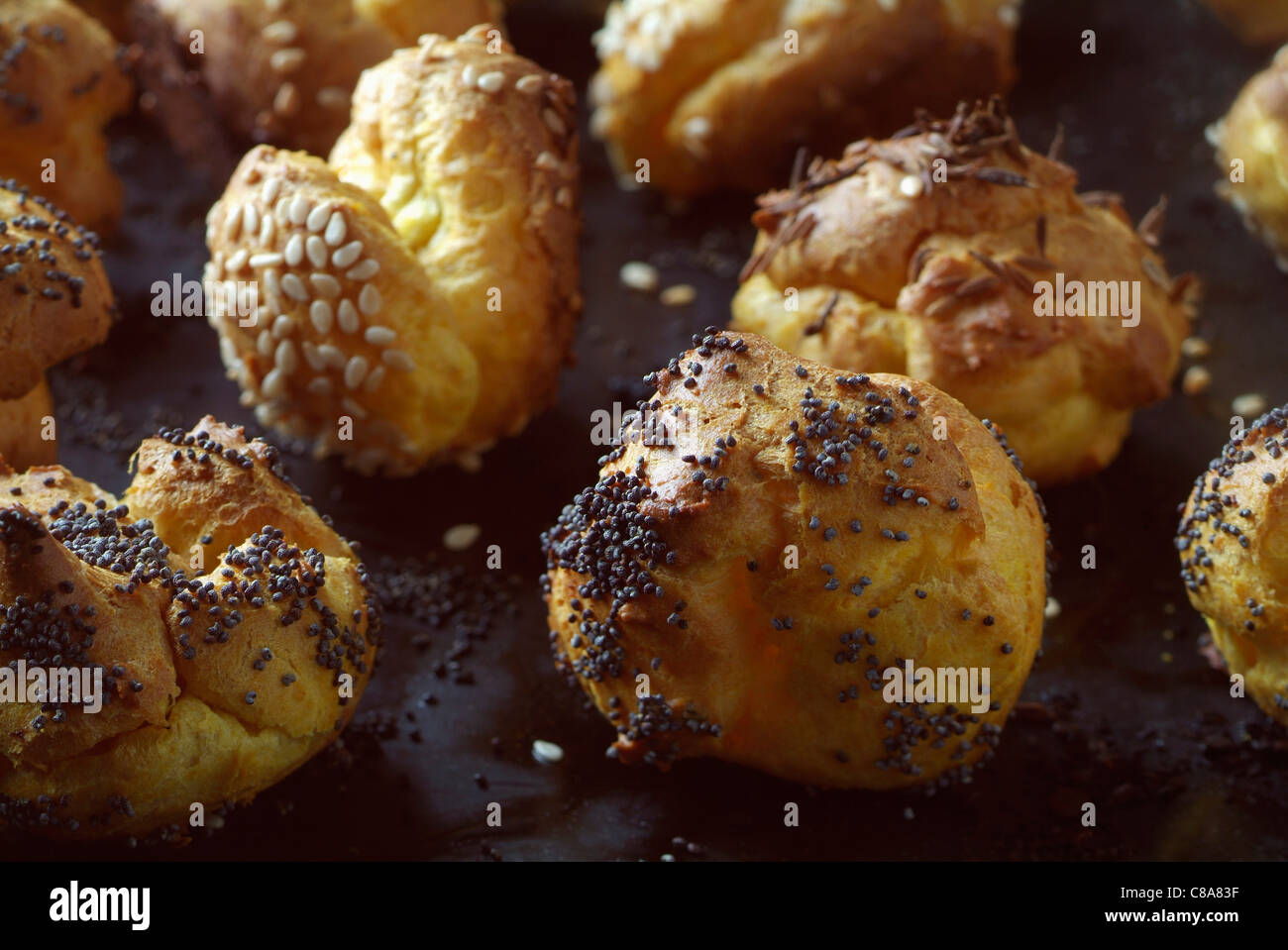 Poppyseed puff pastry appetizers - Stock Image