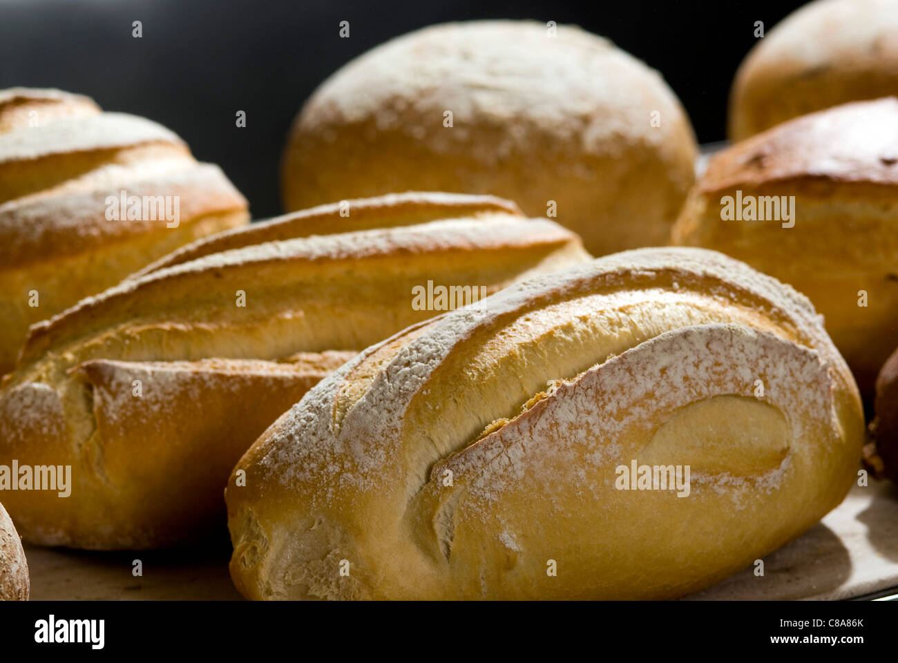 Freshly cooked bread loaves - Stock Image