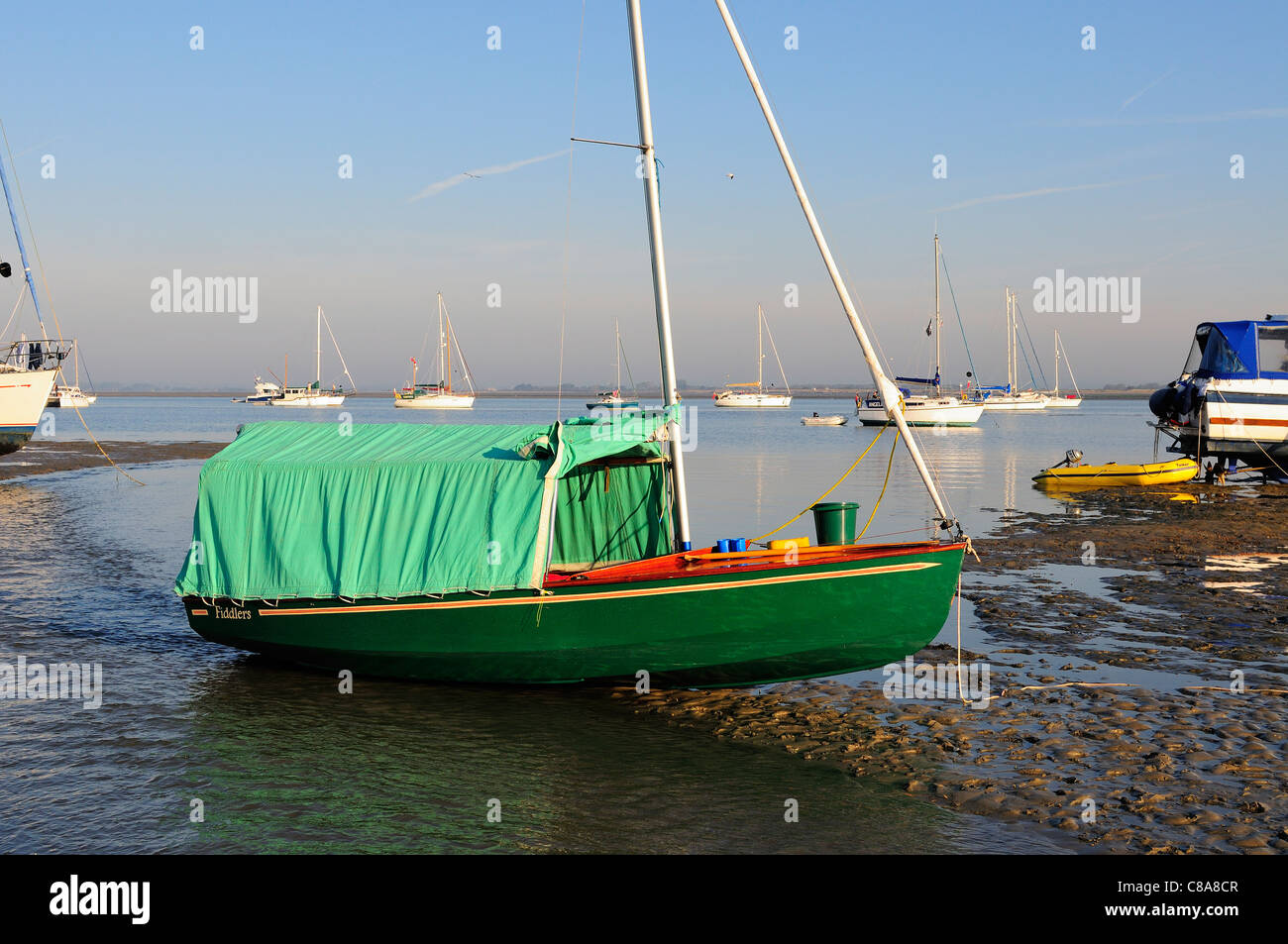 Wayfarer cruising dinghy  with  awning tent ,camping  over night at East Head in Chichester Harbour , West Sussex - Stock Image