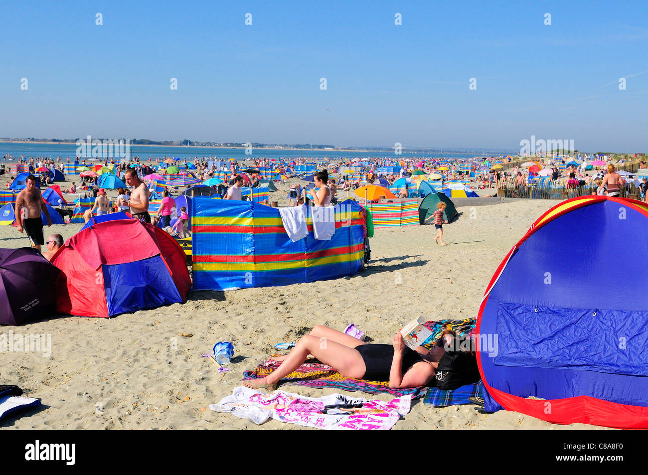 Crowds sunbathing on West Wittering beach during the unusualy hot weekend  of 1st 2nd October 2011 - Stock Image