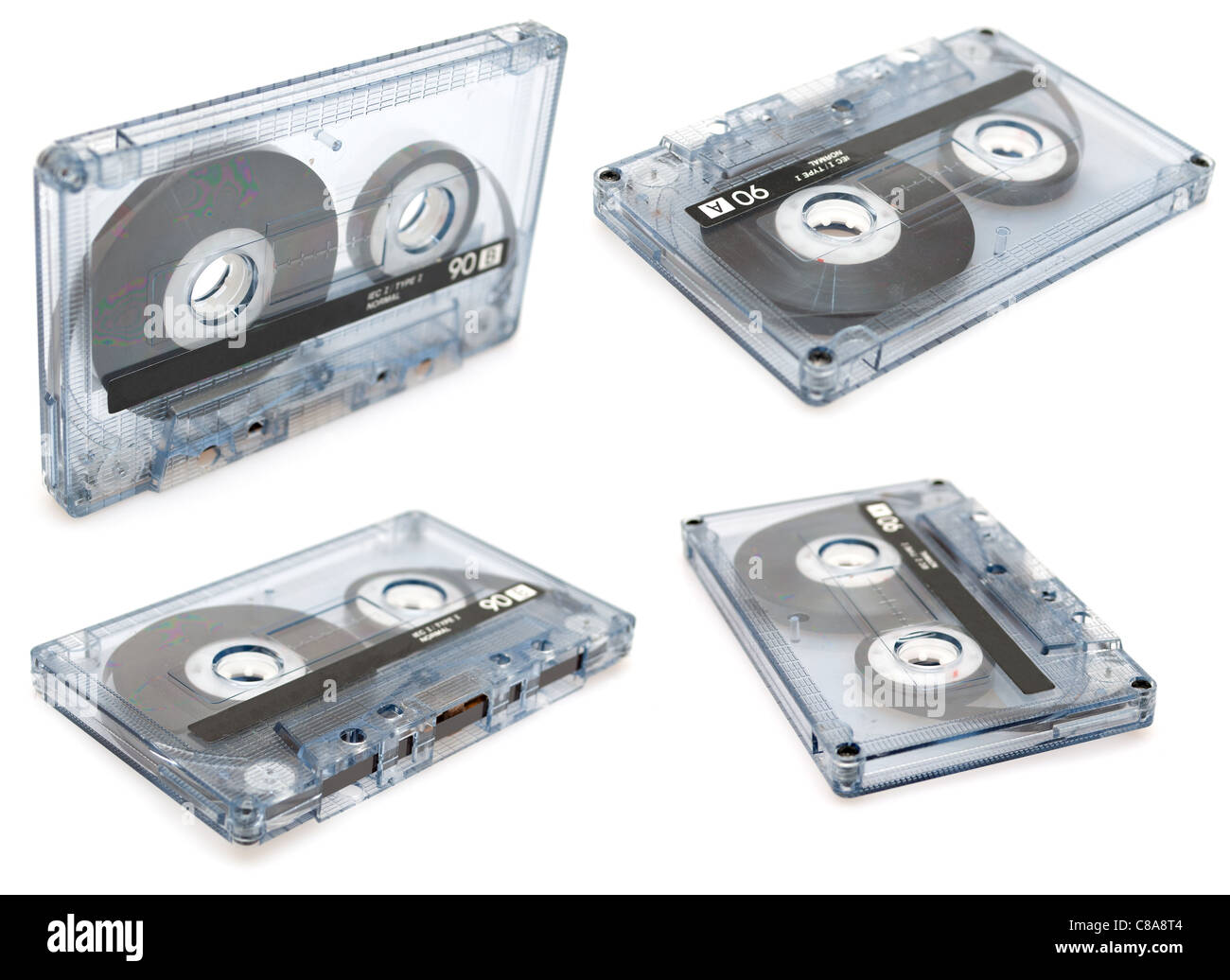 Collection of Retro Audio Cassette Tapes on White Background - Stock Image