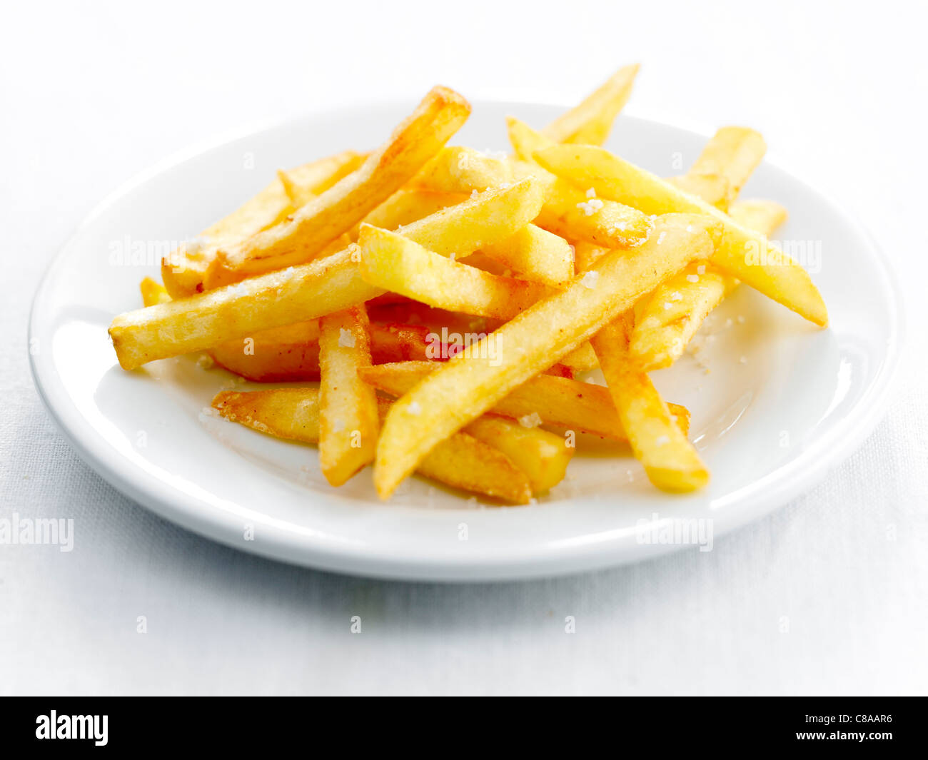 Plate of french fries - Stock Image