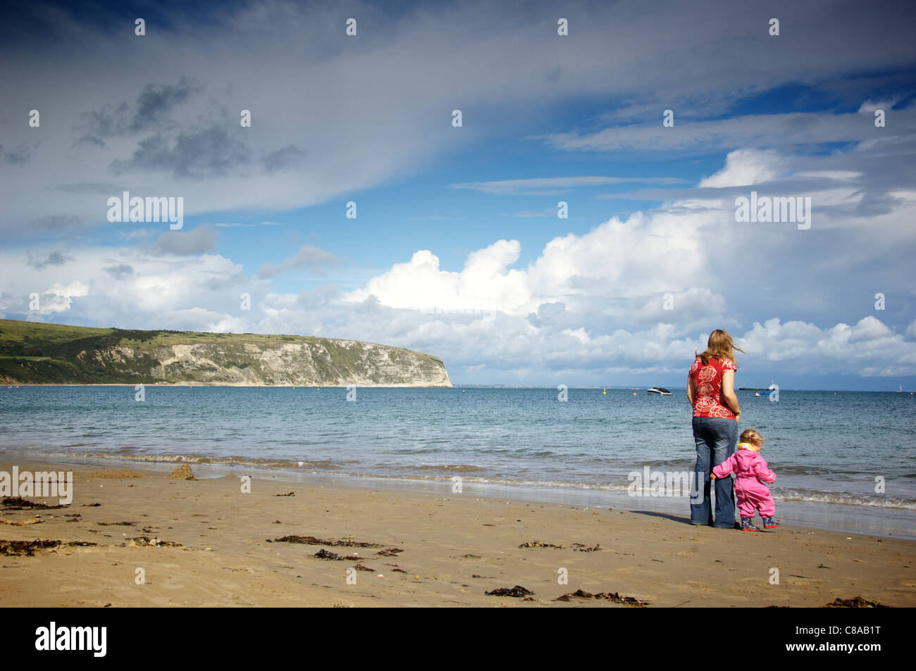Mother and child in Swanage Bay, Dorset - Stock Image