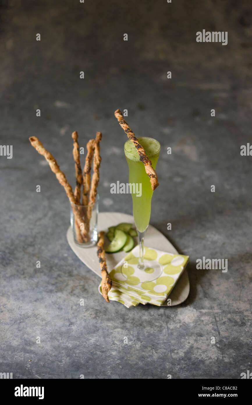 Cucumber juice and poppyseed bread sticks - Stock Image